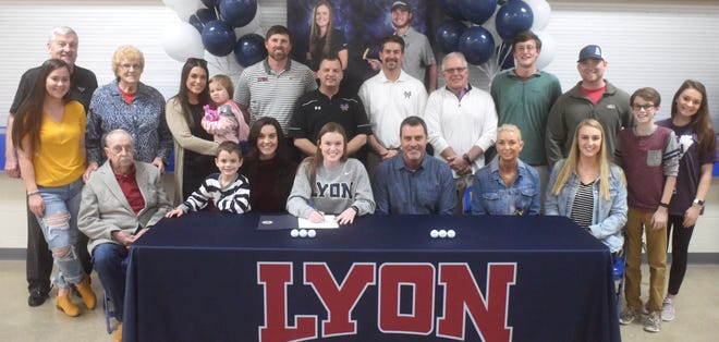 Mountain Home's Kenzie Collins (front, center) signed a National Letter of Intent on Thursday to play golf at Lyon College. Pictured with Collins are: (seated, from left) Freddie Collins, her brother Deacon, Anne-Camille Collins, Sam Collins, Angela Collins, Madeline Collins; (standing) Alivia O'Brien, Rick Woesch, her grandmother Elaine, Grace Crownover and Estella Crownover, Lyon College coach Travis Lauterbach, Mountain Home coach Dell Leonard, Mountain Home volunteer coach Tom Czanstkowski, Big Creek head professional Todd Dunnaway, Chris Wehmeyer, Josh Lewis, Cortland Collins and Sydney Czanstkowski.