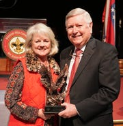 Barney Larry (right), pictured with his wife, Debbie, is shown with the Golden Eagle Award presented by the Boy Scounts of America. The award was given to Larry for his outstanding contributions as a leader in the local healthcare fields, his dedicated community service and for his music ministry in his church.