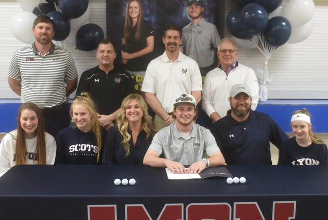 Mountain Home's Luke Jackson (front, center) signed Thursday a National Letter of Intent to play golf at Lyon College in Batesville. Pictured with Jackson are: (seated, from left) Cate Jackson, Leah Jackson, LeeAnne Jackson,  Craig Jackson, Cara Jackson; (standing) Lyon golf coach Travis Lauterbach, Mountain Home golf coach Dell Leonard, Mountain Home assitant golf coach Tom Czanstkowski, and Big Creek head professional Todd Dunnaway.