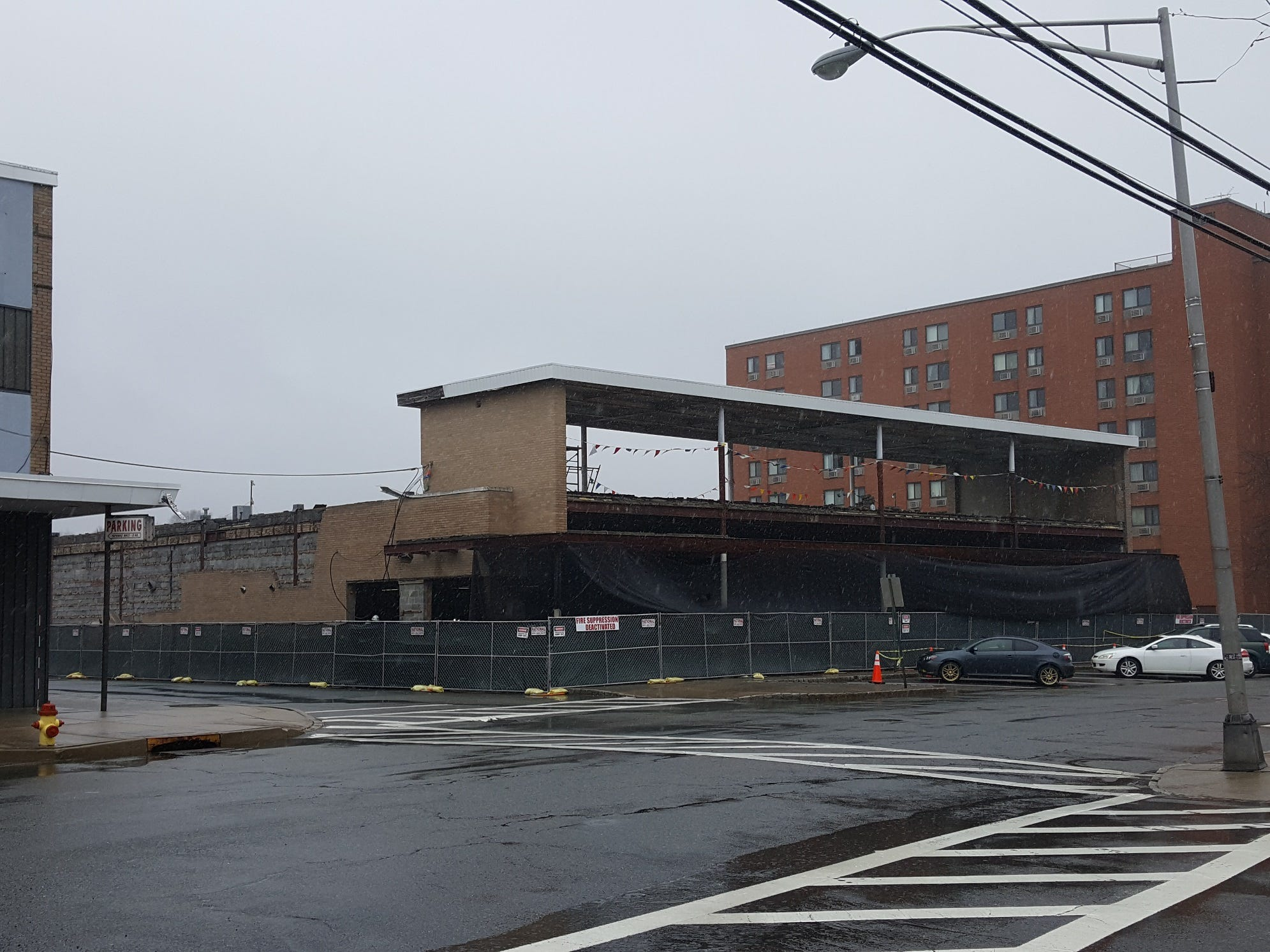 Photos of 47 Bassett Highway, formerly a JC Penney store and a flag factory before being redeveloped into a church for the Church of Jesus Christ of Latter Day Saints in Dover.