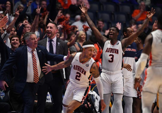 Auburn forward Danjel Purifoy (3) head coach Bruce Pearl celebrate after a basket by guard Bryce Brown (2) during a game against Missouri at the SEC Tournament on March 14, 2019, in Nashville, Tenn.