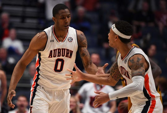 Auburn guard Bryce Brown (2) and forward Horace Spencer (0) celebrate after a basket during the second half against Missouri in the SEC Tournament at Bridgestone Arena on March 14, 2019.