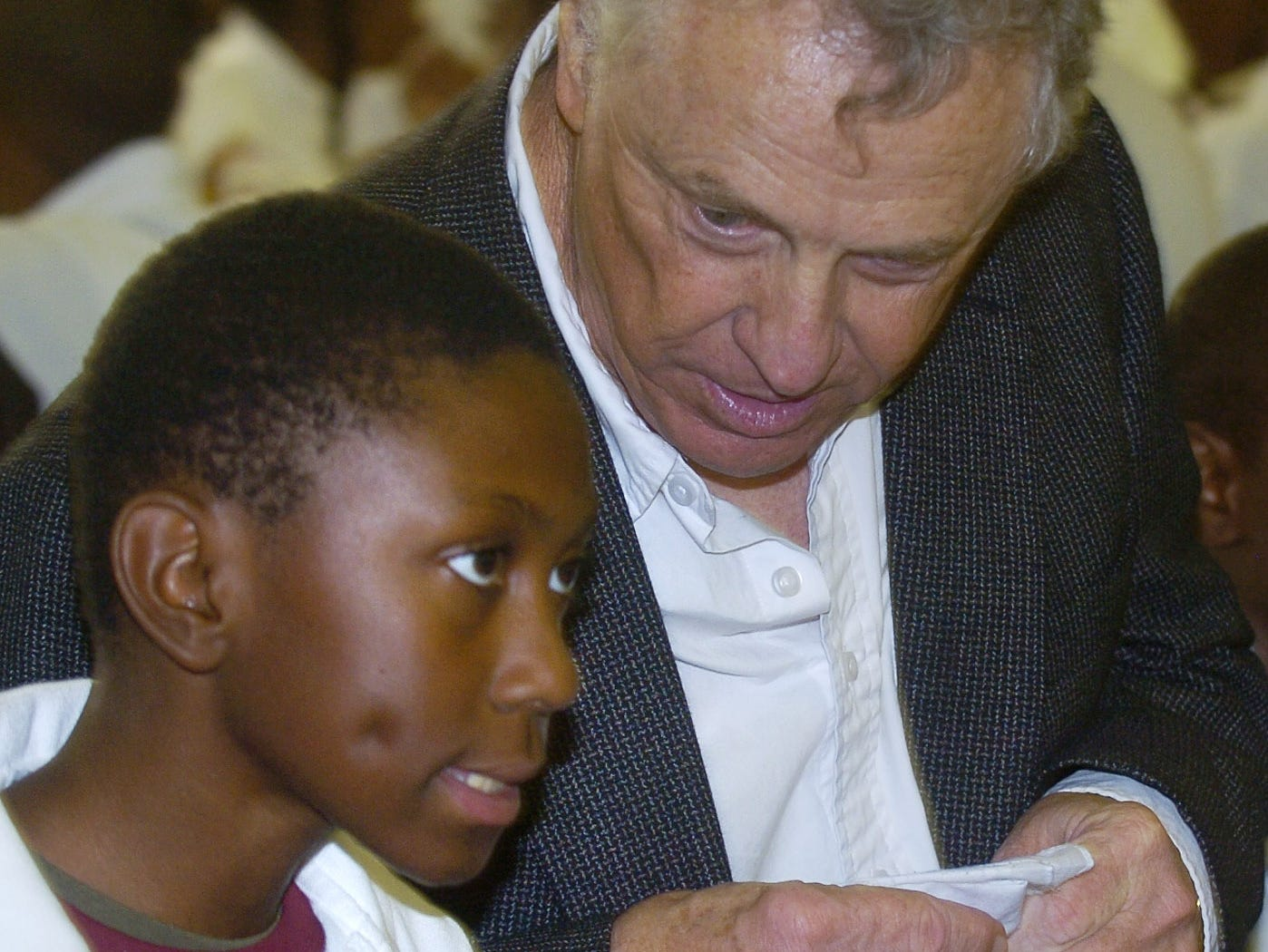 November 13, 2007 - Southern Poverty Law Center co-founder Morris Dees, right, visits with Justin Downer while eating lunch with students during the Mix It Up at Lunch Day program at Floyd Elementary School in Montgomery, Ala. on Tuesday November 13, 2007. Mix It Up is part of the Teaching Tolerance program. 10,000 schools and over four million students are taking part in the program. (Montgomery Advertiser, Mickey Welsh)