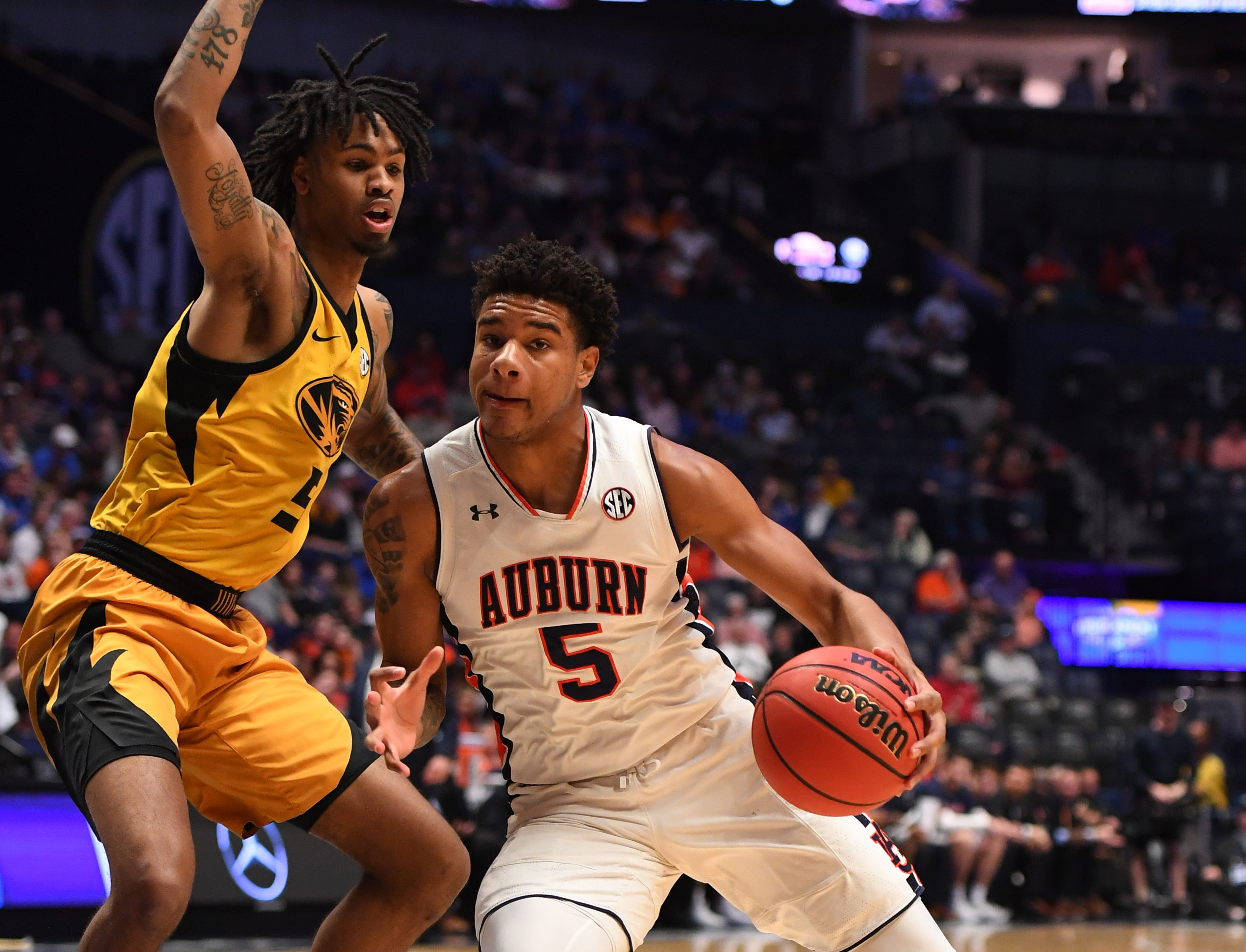 Mar 14, 2019; Nashville, TN, USA; Auburn Tigers forward Chuma Okeke (5) works against Missouri Tigers forward Mitchell Smith (5) during the first half of the SEC conference tournament at Bridgestone Arena. Mandatory Credit: Christopher Hanewinckel-USA TODAY Sports