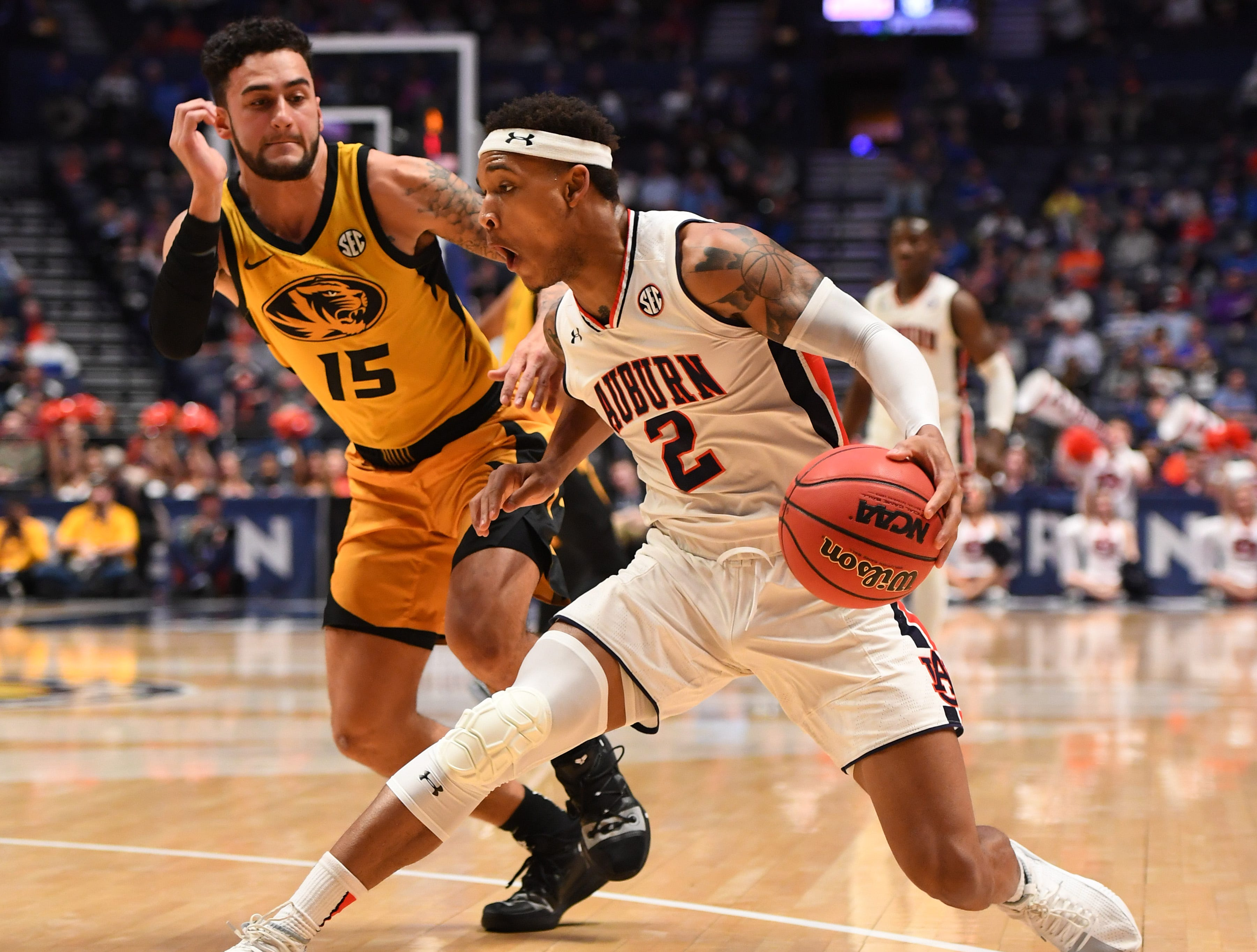 Mar 14, 2019; Nashville, TN, USA; Auburn Tigers guard Bryce Brown (2) works against Missouri Tigers guard Jordan Geist (15) during the first half of the SEC conference tournament at Bridgestone Arena. Mandatory Credit: Christopher Hanewinckel-USA TODAY Sports