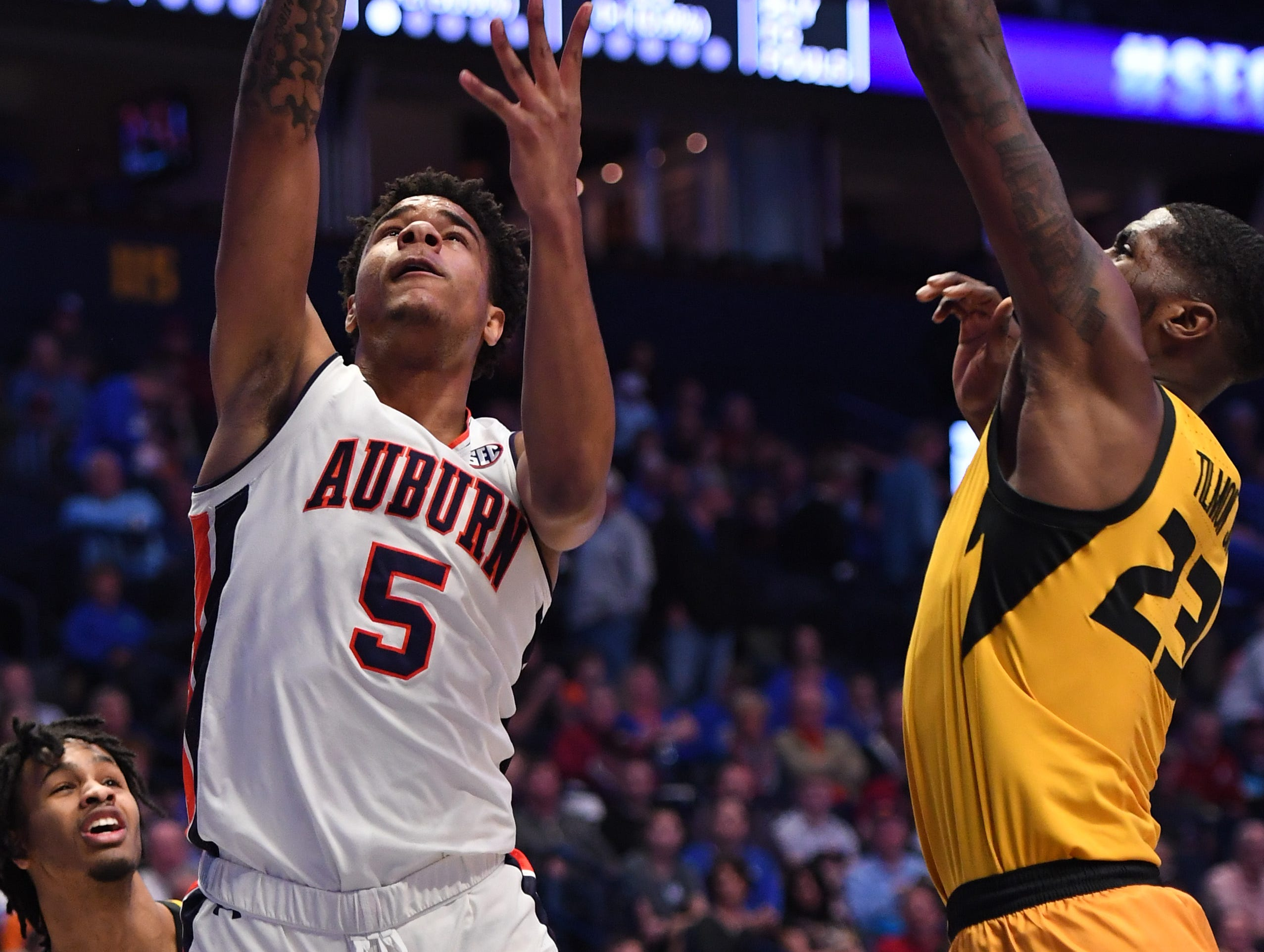 Mar 14, 2019; Nashville, TN, USA; Auburn Tigers forward Chuma Okeke (5) attempts a shot against Missouri Tigers forward Jeremiah Tilmon (23) during the first half of the SEC conference tournament at Bridgestone Arena. Mandatory Credit: Christopher Hanewinckel-USA TODAY Sports