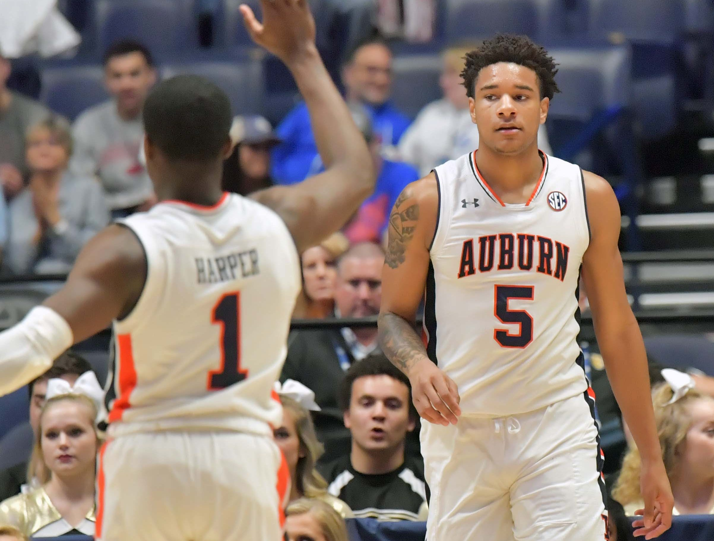 Mar 14, 2019; Nashville, TN, USA; Auburn Tigers forward Chuma Okeke (5) and guard Jared Harper (1) react in the first half Auburn Tigers mascot entertains fans  in the SEC conference tournament at Bridgestone Arena. Mandatory Credit: Jim Brown-USA TODAY Sports