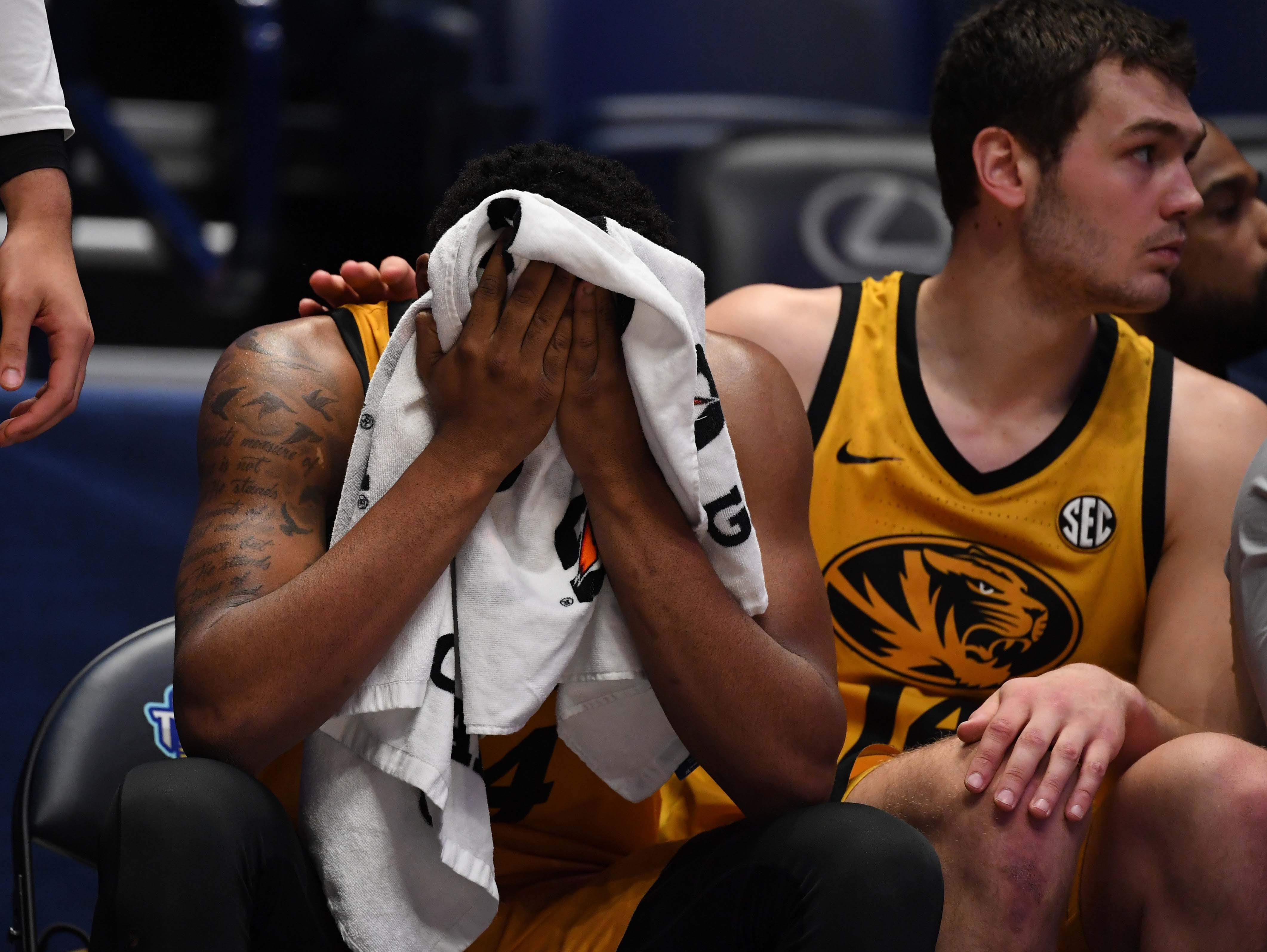 Mar 14, 2019; Nashville, TN, USA; Missouri Tigers forward Kevin Puryear (24) and forward Reed Nikko (14) on the bench late in the game of a loss against the Auburn Tigers in the SEC conference tournament at Bridgestone Arena. Mandatory Credit: Christopher Hanewinckel-USA TODAY Sports