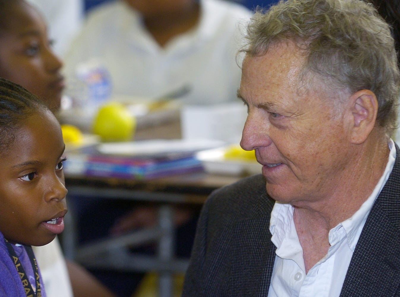 November 13, 2007 - Southern Poverty Law Center co-founder Morris Dees, right, pauses to chat with Eboni Graham, left, in the cafeteria at Floyd Elementary school during the Mix It Up at Lunch Day program at the school in Montgomery, Ala. on Tuesday November 13, 2007. Mix It Up is part of the Teaching Tolerance program. 10,000 schools and over four million students are taking part in the program. (Montgomery Advertiser, Mickey Welsh)
