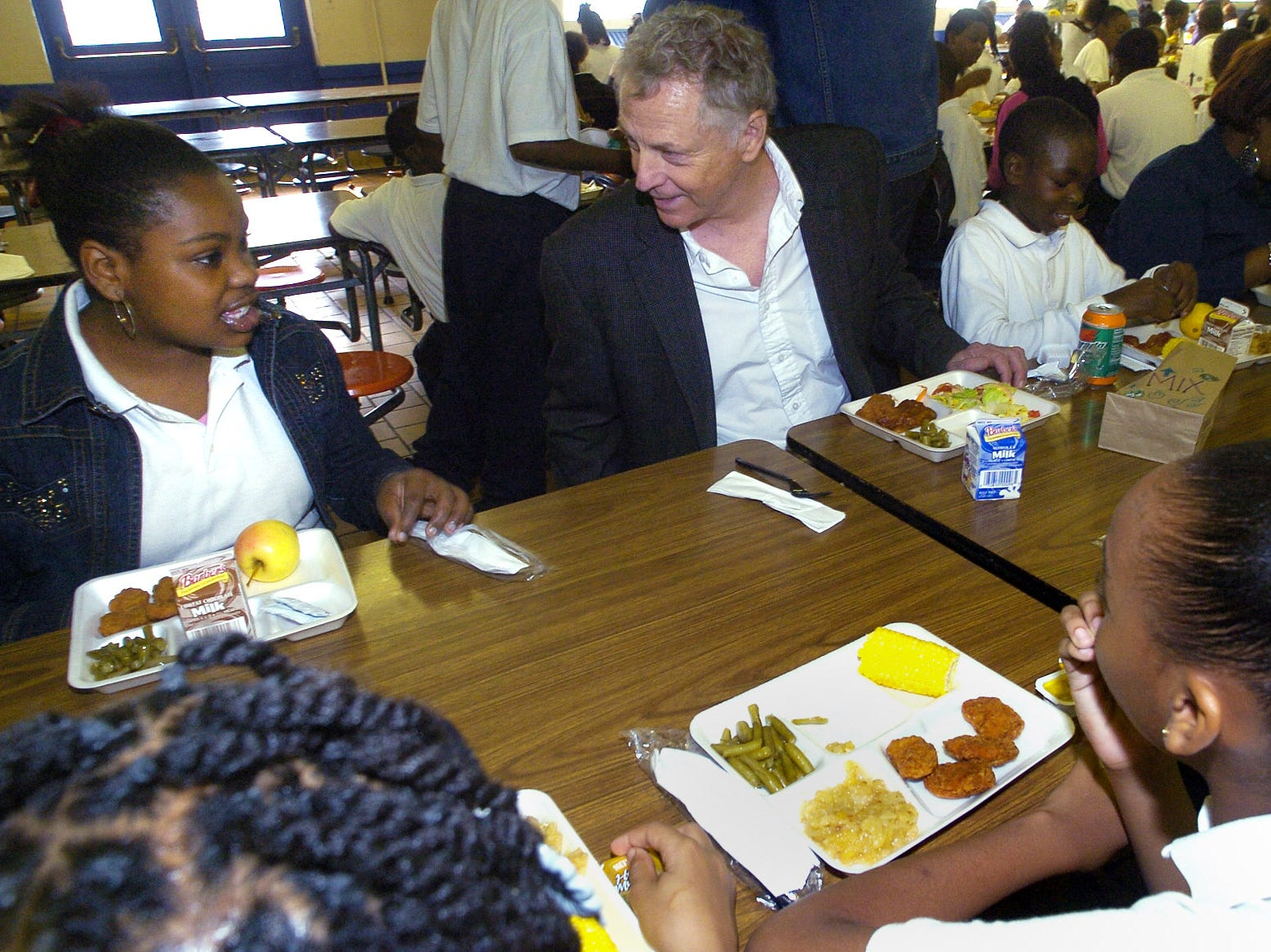 November 13, 2007 - Southern Poverty Law Center co-founder Morris Dees, right, visits with Jakira Hall, left, while eating lunch with students during the Mix It Up at Lunch Day program at Floyd Elementary School in Montgomery, Ala. on Tuesday November 13, 2007. Mix It Up is part of the Teaching Tolerance program. 10,000 schools and over four million students are taking part in the program. (Montgomery Advertiser, Mickey Welsh)