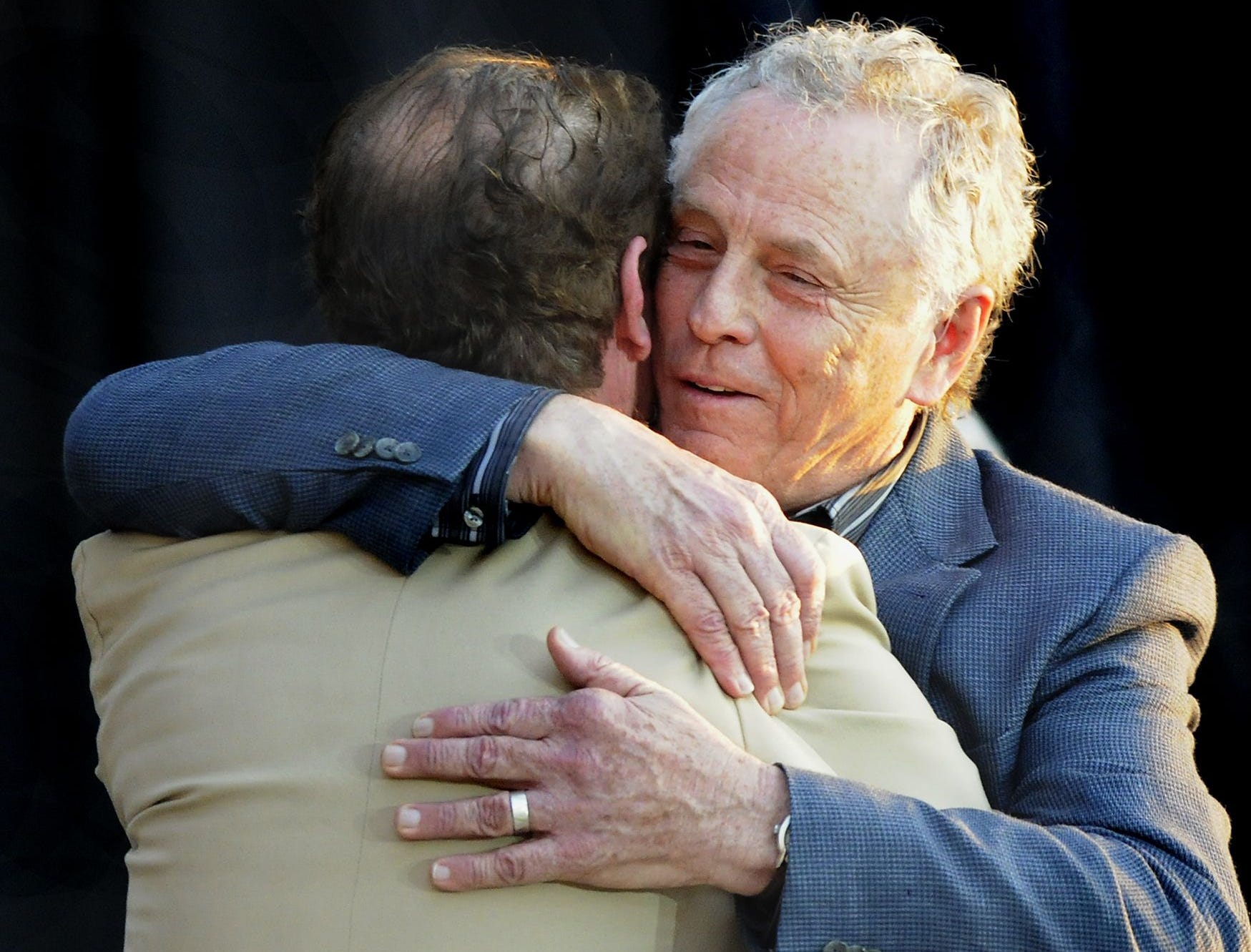 Morris Dees hugs supporter Donald McGrath at the Southern Poverty Law Center's 40th Anniversary Celebration on Saturday April 30, 2011 at the Civil Rights Memorial Center in Montgomery, Ala.(Montgomery Advertiser, Mickey Welsh)