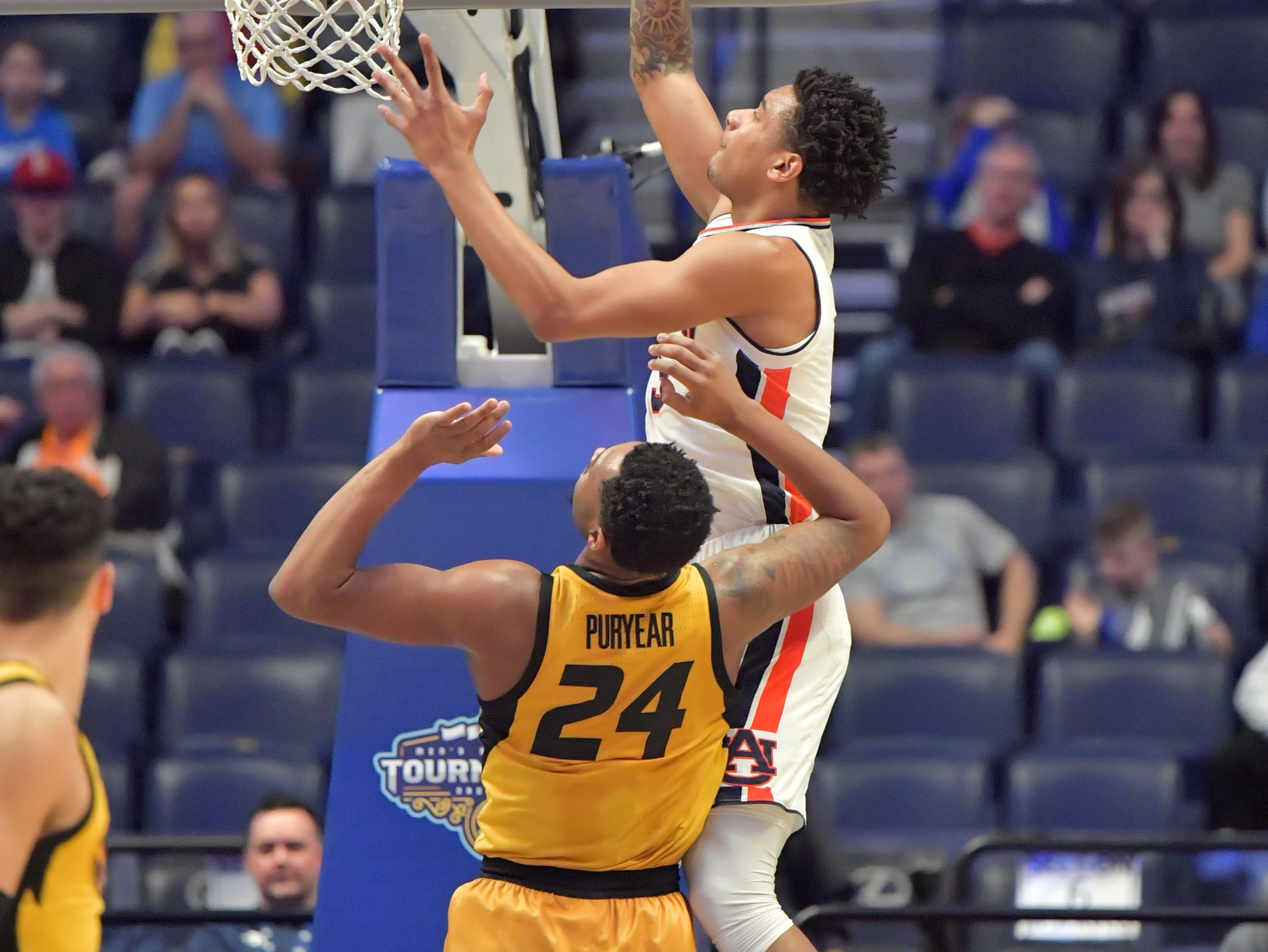 Mar 14, 2019; Nashville, TN, USA; Auburn Tigers forward Chuma Okeke (5) shoots the ball as Missouri Tigers forward Kevin Puryear (24) defends in the first half in the SEC conference tournament at Bridgestone Arena. Mandatory Credit: Jim Brown-USA TODAY Sports
