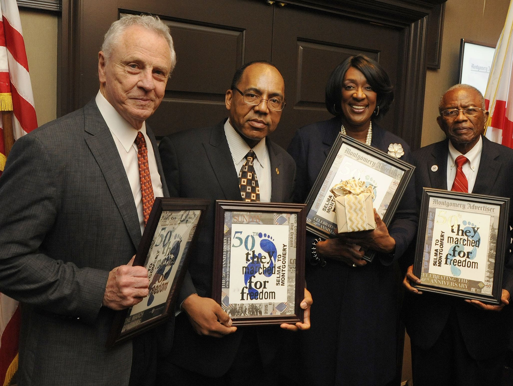 Speakers, Morris Dees, Vann Newkirk, Gwendolyn Boyd and Fred Gray pose following the Montgomery Advertiser 50th Anniversary of the Selma to Montgomery March Celebration at the Capitol City Club in Montgomery, Ala. on Tuesday March 10, 2015.
