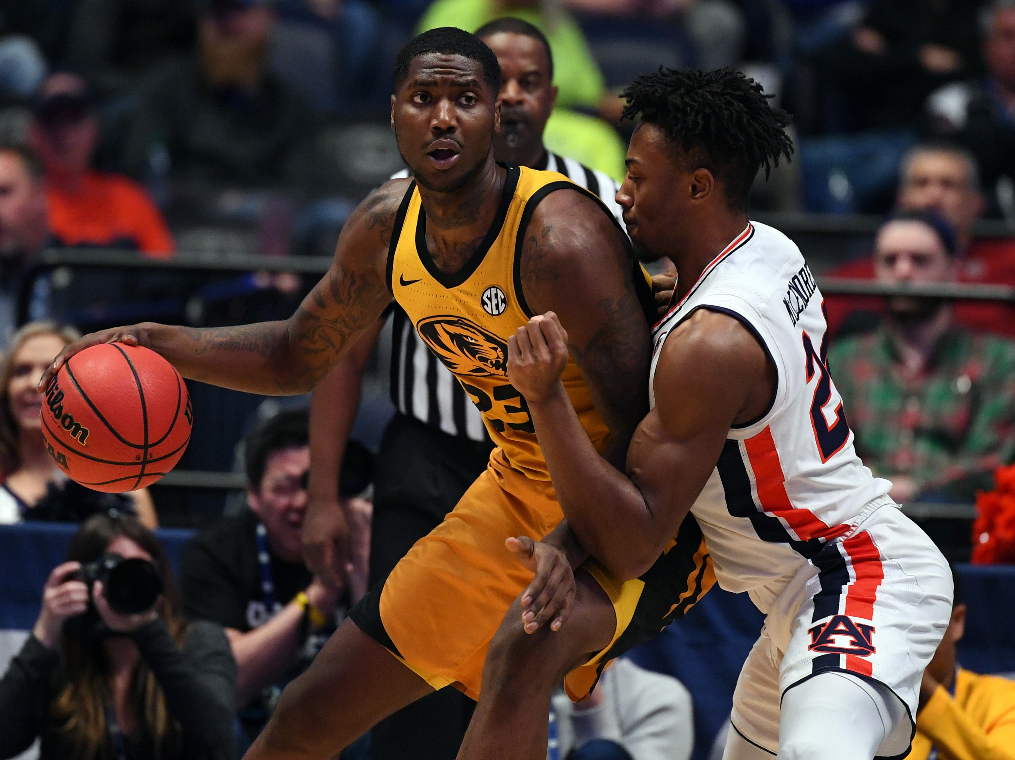 Mar 14, 2019; Nashville, TN, USA; Missouri Tigers forward Jeremiah Tilmon (23) works against Auburn Tigers forward Anfernee McLemore (24) during the first half of the SEC conference tournament at Bridgestone Arena. Mandatory Credit: Christopher Hanewinckel-USA TODAY Sports