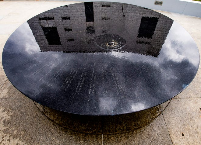 The Southern Poverty Law Center building is reflected in the Civil Rights Memorial in Montgomery, Ala., on Thursday March 14, 2019.