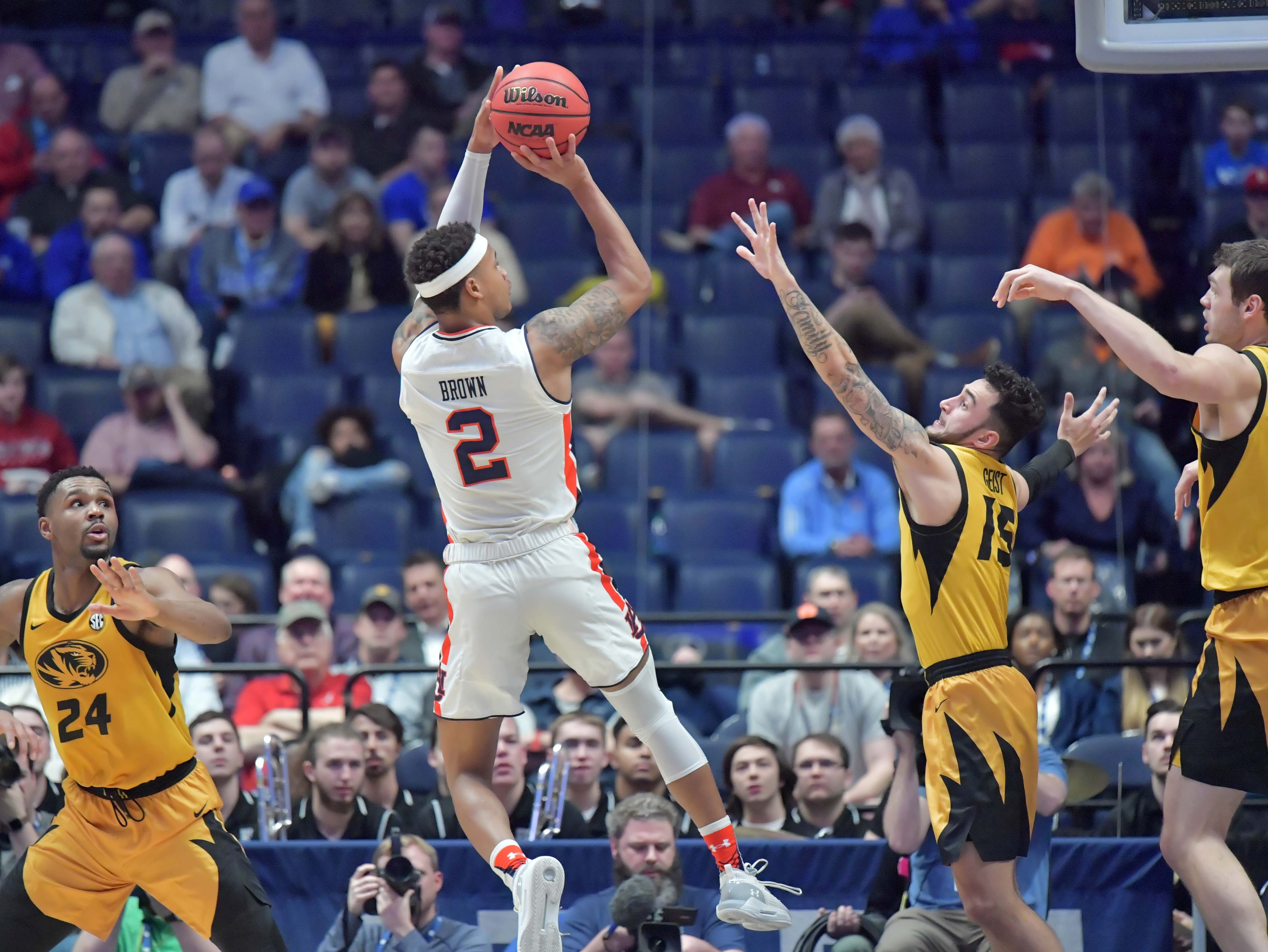 Mar 14, 2019; Nashville, TN, USA; Auburn Tigers guard Bryce Brown (2) shoots the ball as Missouri Tigers guard Jordan Geist (15) defends  in the SEC conference tournament at Bridgestone Arena. Mandatory Credit: Jim Brown-USA TODAY Sports