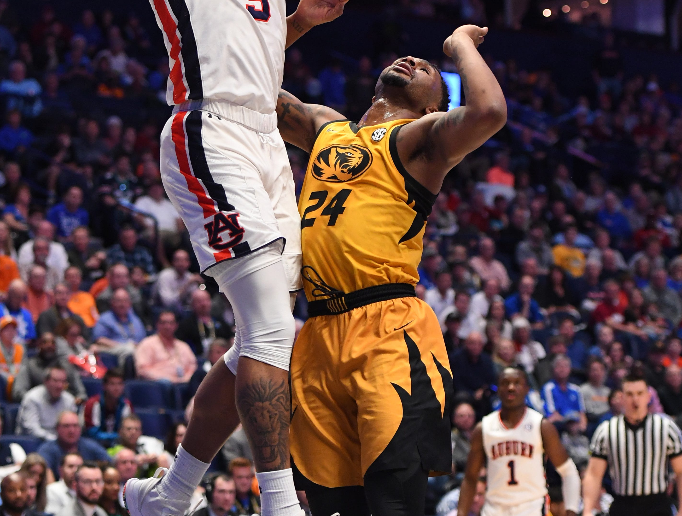 Mar 14, 2019; Nashville, TN, USA; Auburn Tigers forward Chuma Okeke (5) scores a basket against Missouri Tigers forward Kevin Puryear (24) during the first half of the SEC conference tournament at Bridgestone Arena. Mandatory Credit: Christopher Hanewinckel-USA TODAY Sports