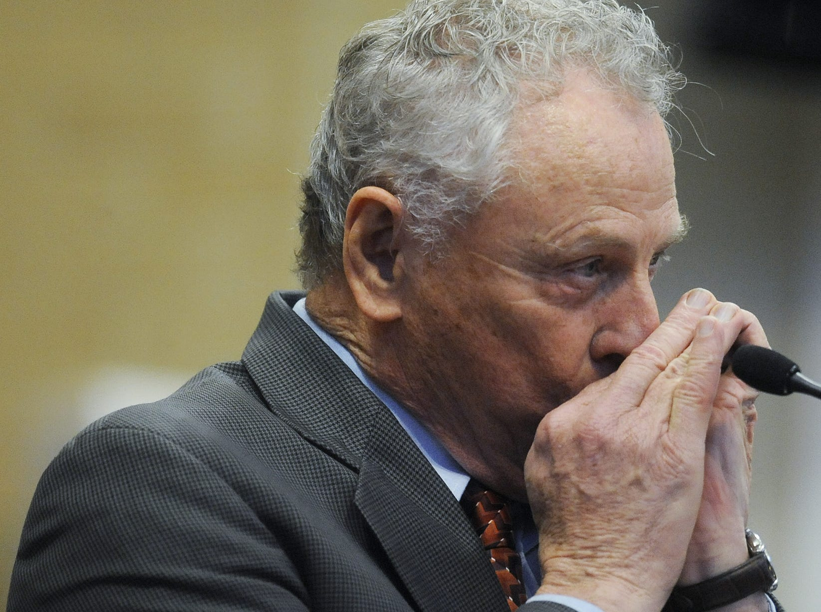Morris Dees plays the harmonica during the memorial service for Nick LaTour at Hutchinson Missionary Baptist Church in Montgomery, Ala. on Saturday April 2, 2011. (Montgomery Advertiser, Mickey Welsh)