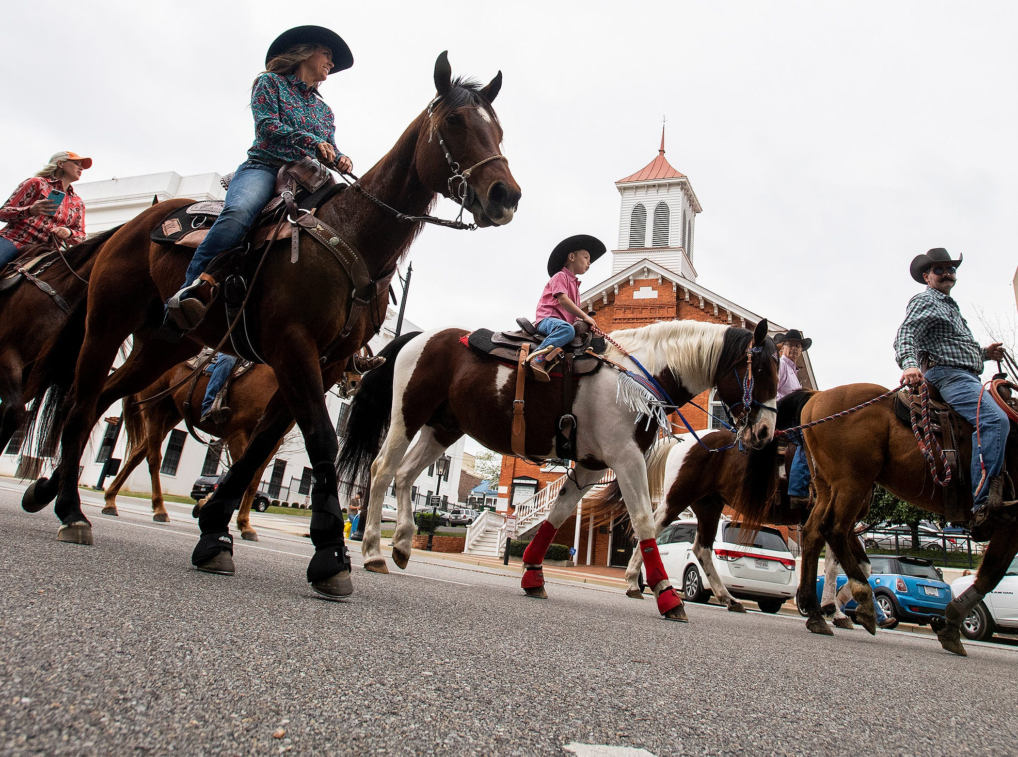 A wagon train and Rodeo Kick off Parade rides by the Dexter Avenue King memorial Baptist Church in Montgomery, Ala., on Thursday March 14, 2019 promoting the SLE Rodeo which runs through Saturday at Garrett Coliseum.