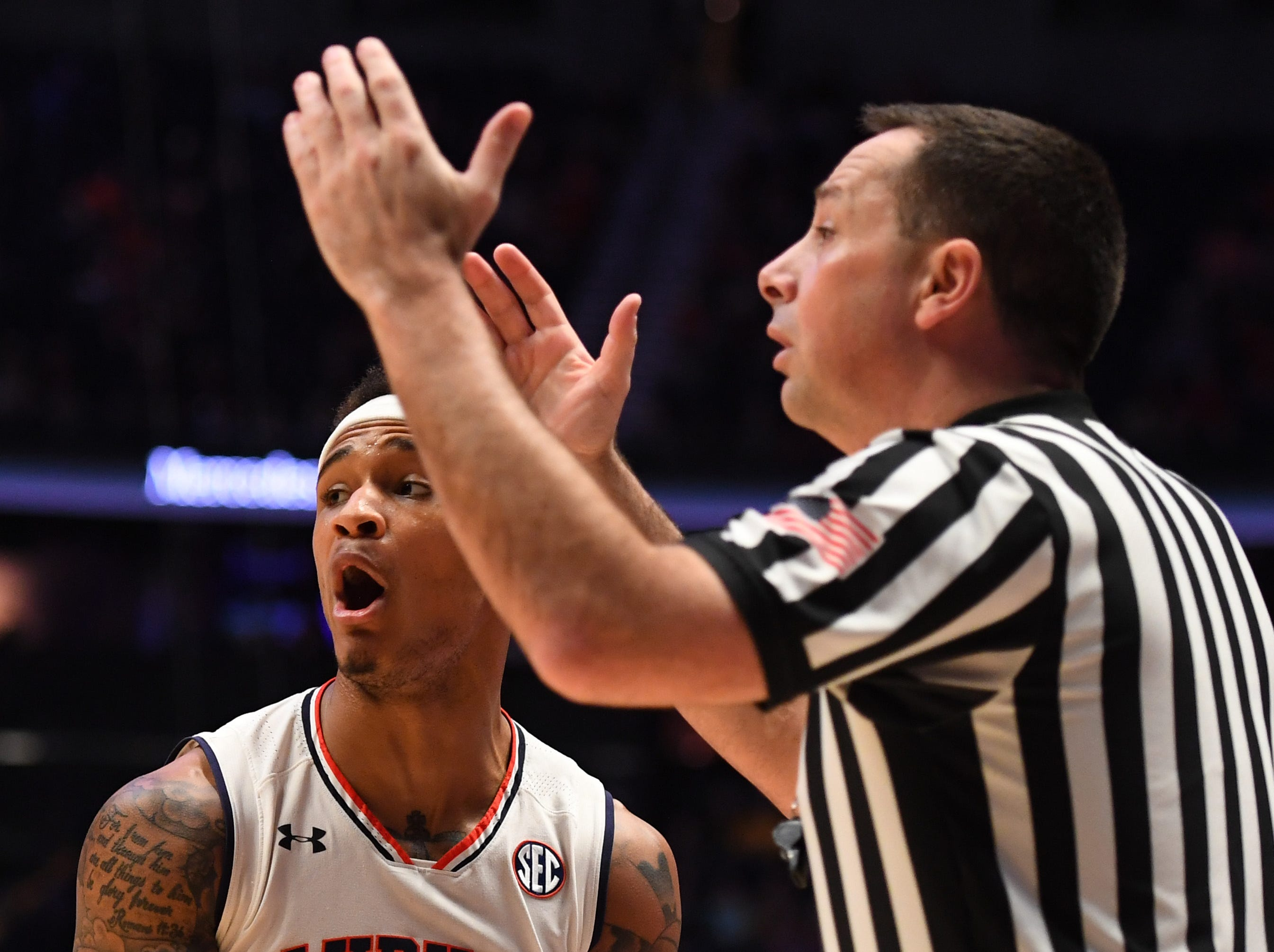 Mar 14, 2019; Nashville, TN, USA; Auburn Tigers guard Bryce Brown (2) disagrees with a call by the referees against the Missouri Tigers during the first half of the SEC conference tournament at Bridgestone Arena. Mandatory Credit: Christopher Hanewinckel-USA TODAY Sports