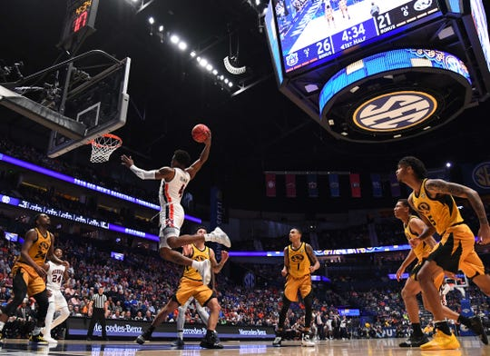 Auburn guard Malik Dunbar (4) dunks the ball against Missouri during the first half of an SEC Tournament game at Bridgestone Arena on March 14, 2019, in Nashville, Tenn.