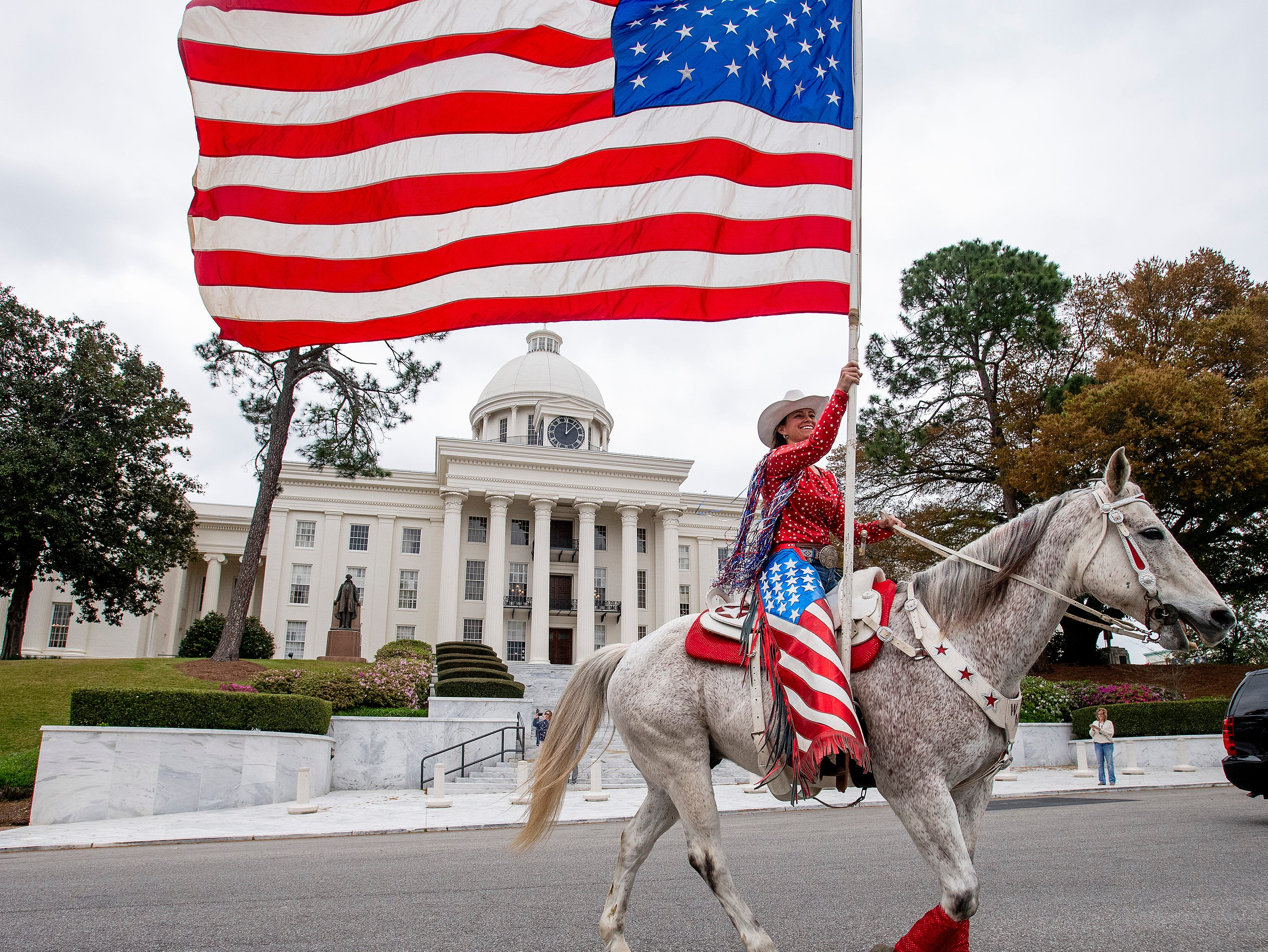 A wagon train and Rodeo Kick off Parade rides by the state capitol building in Montgomery, Ala., on Thursday March 14, 2019 promoting the SLE Rodeo which runs through Saturday at Garrett Coliseum.