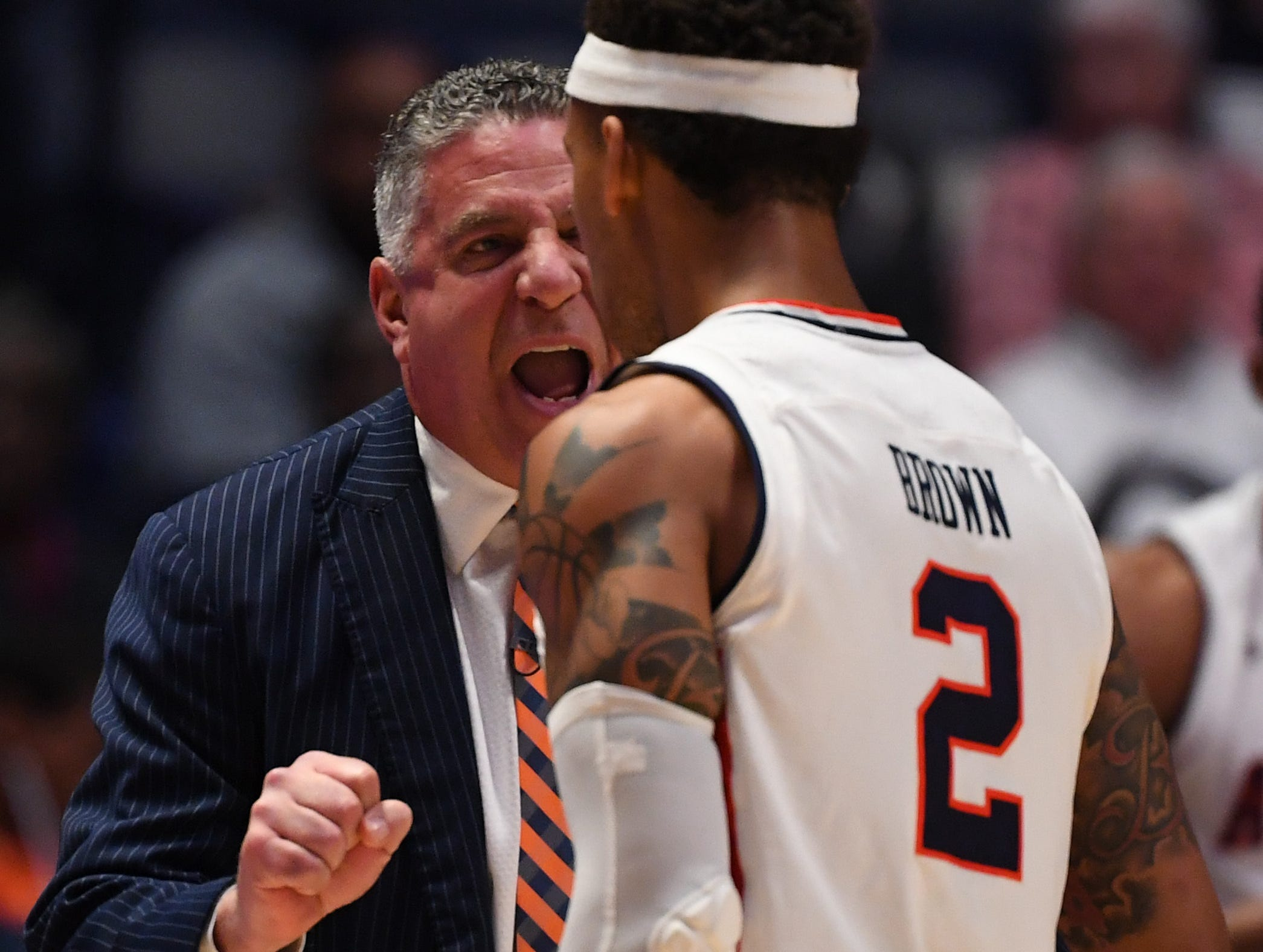 Mar 14, 2019; Nashville, TN, USA; Auburn Tigers head coach Bruce Pearl talks with guard Bryce Brown (2) against the Missouri Tigers during the first half of the SEC conference tournament at Bridgestone Arena. Mandatory Credit: Christopher Hanewinckel-USA TODAY Sports