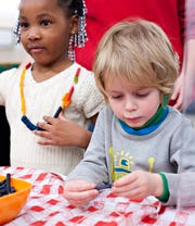 All ages enjoy activities at a past Family Adventure Day at Minnetrista.