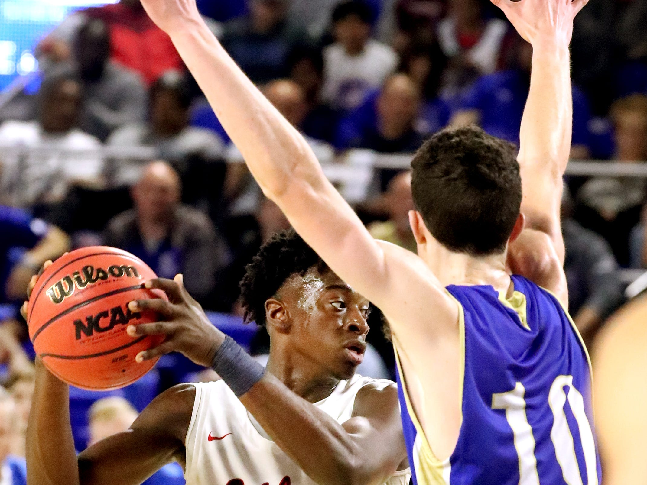 Oakland's Dearre McDonald (3) looks to pass the ball as Brentwood's John Windley (10) guards him during the quarterfinal round of the TSSAA Class AAA Boys State Tournament, on Thursday, March 14, 2019, at Murphy Center in Murfreesboro, Tenn.