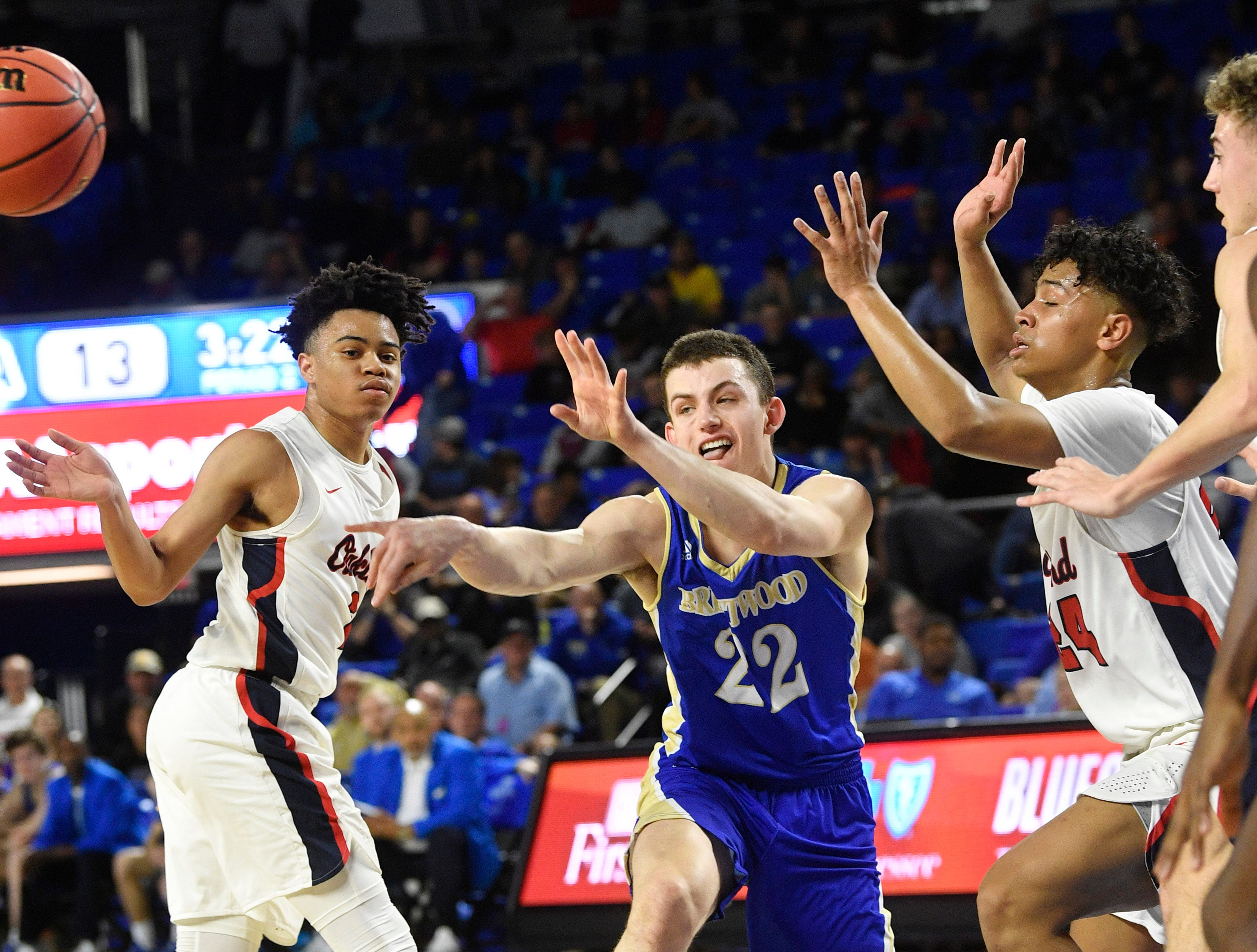 Brentwood's Harry Lackey (22) passes off as Brentwood plays Oaklandin the TSSAA Class AAA quarterfinals  Thursday, March 14, 2019, in Murfreesboro, Tenn.