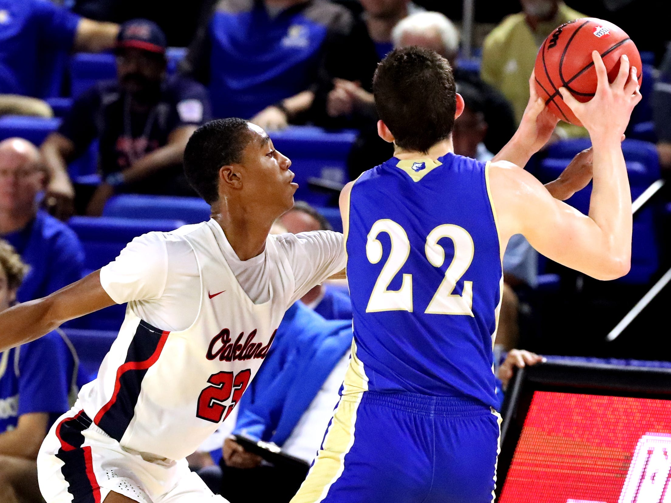 Oakland's Dorian Anderson (23) tries to take the ball away from Brentwood's Harry Lackey (22) during the quarterfinal round of the TSSAA Class AAA Boys State Tournament, on Thursday, March 14, 2019, at Murphy Center in Murfreesboro, Tenn.