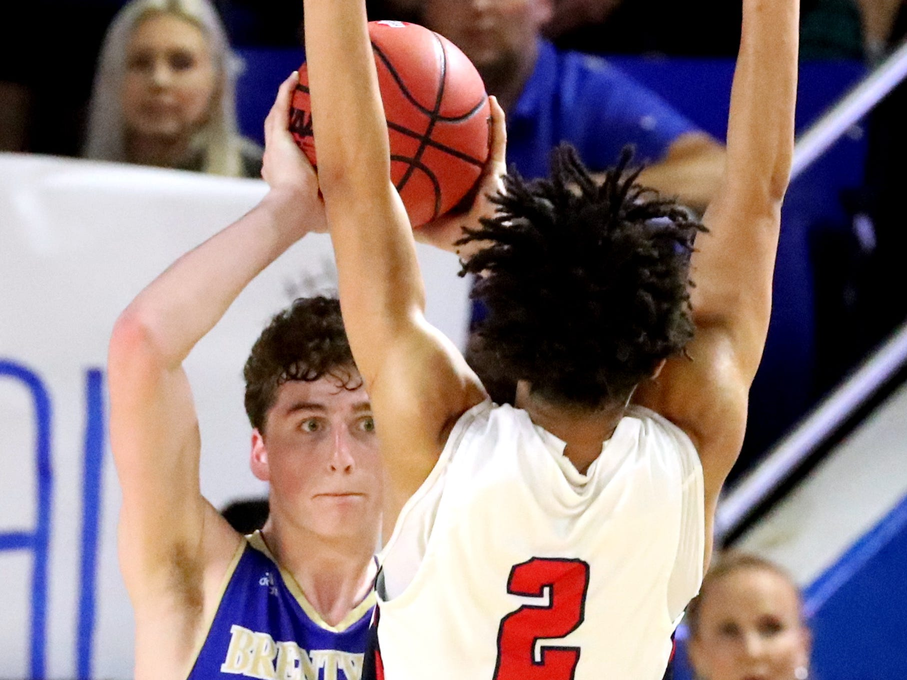 Brentwood's Ben Mills (34) looks to pass the ball as Oakland's Lonnie Tyler (2) guards him during the quarterfinal round of the TSSAA Class AAA Boys State Tournament, on Thursday, March 14, 2019, at Murphy Center in Murfreesboro, Tenn.