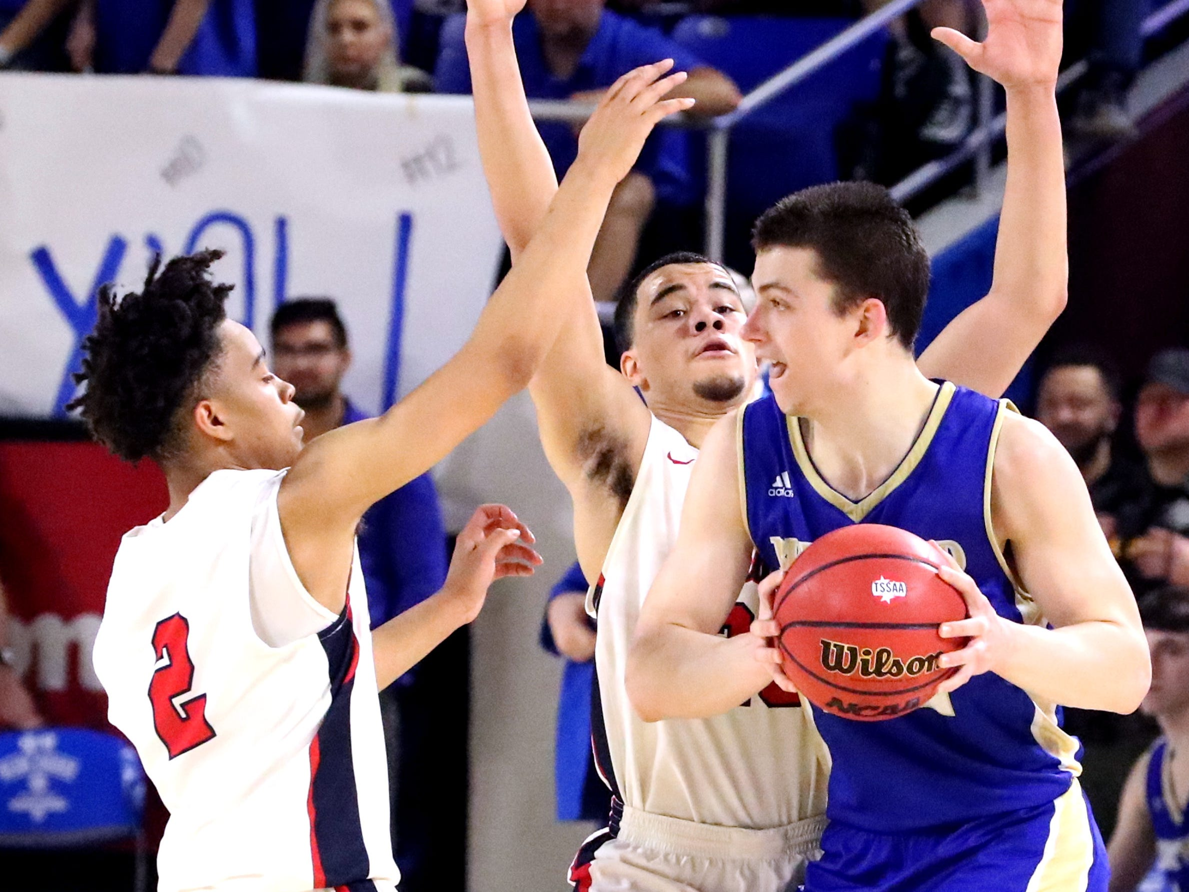 Brentwood's Harry Lackey (22) looks to pass the ball as Oakland's Lonnie Tyler (2) and Lamarius Jackson (25) guard him during the quarterfinal round of the TSSAA Class AAA Boys State Tournament, on Thursday, March 14, 2019, at Murphy Center in Murfreesboro, Tenn.