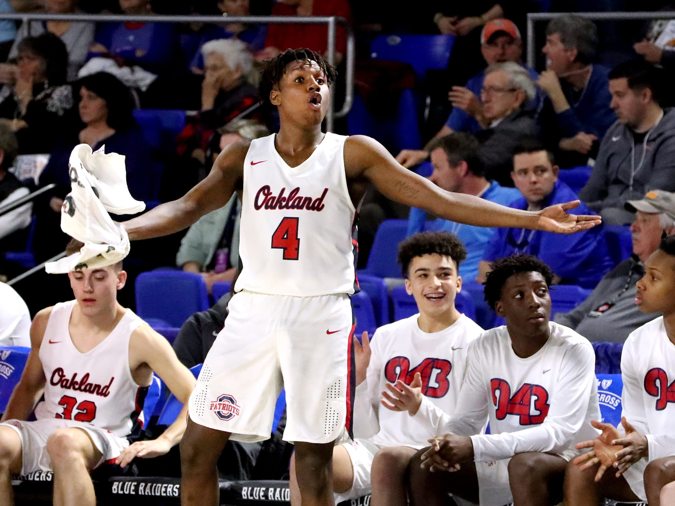 Oakland's Mandrell Grant (4) tries to get the crowd pumped as the game is tied late in the fourth quarter during the quarterfinal round of the TSSAA Class AAA Boys State Tournament, against Brentwood, on Thursday, March 14, 2019, at Murphy Center in Murfreesboro, Tenn.