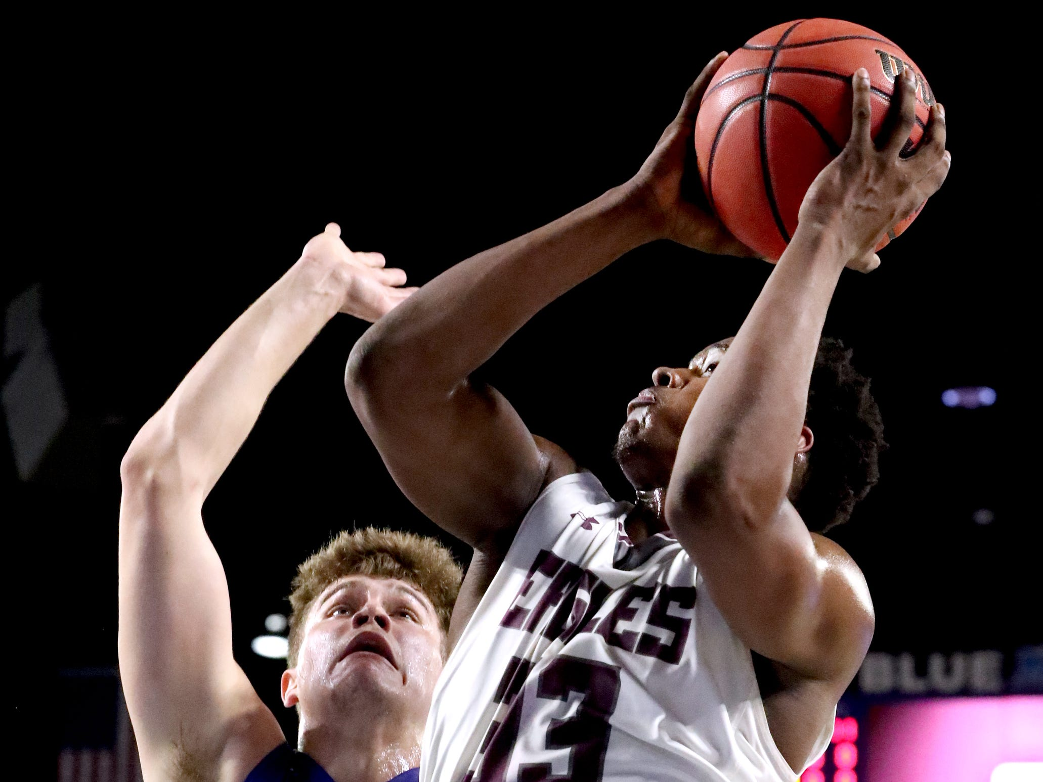 Eagleville's Demarious Stoudemire (33) shoots the ball as Cosby's Austin McKeehan (13) guards him during the quarterfinal round of the TSSAA Class A Boys State Tournament, on Thursday, March 14, 2019, at Murphy Center in Murfreesboro, Tenn.
