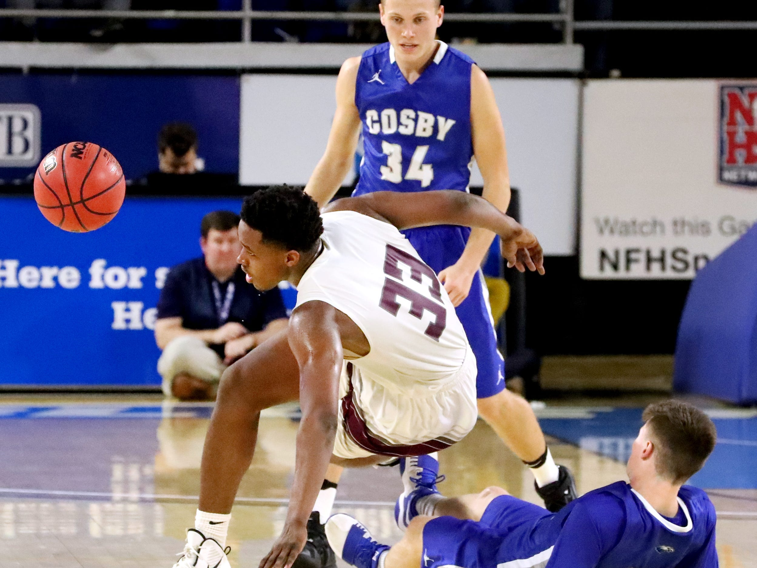 Eagleville's Demarious Stoudemire (33) and Cosby's Jeremy Wise (24) fall to the floor as Cosby's Seth Arwood (34) looks on as Stoudemire brings the ball up court during the quarterfinal round of the TSSAA Class A Boys State Tournament, on Thursday, March 14, 2019, at Murphy Center in Murfreesboro, Tenn.