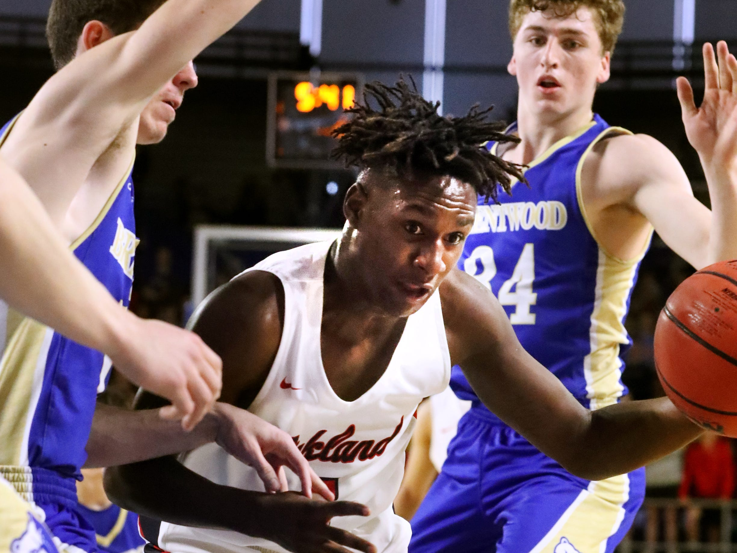 Oakland's Mandrell Grant (4) drives to the basket during the quarterfinal round of the TSSAA Class AAA Boys State Tournament against Brentwood, on Thursday, March 14, 2019, at Murphy Center in Murfreesboro, Tenn.