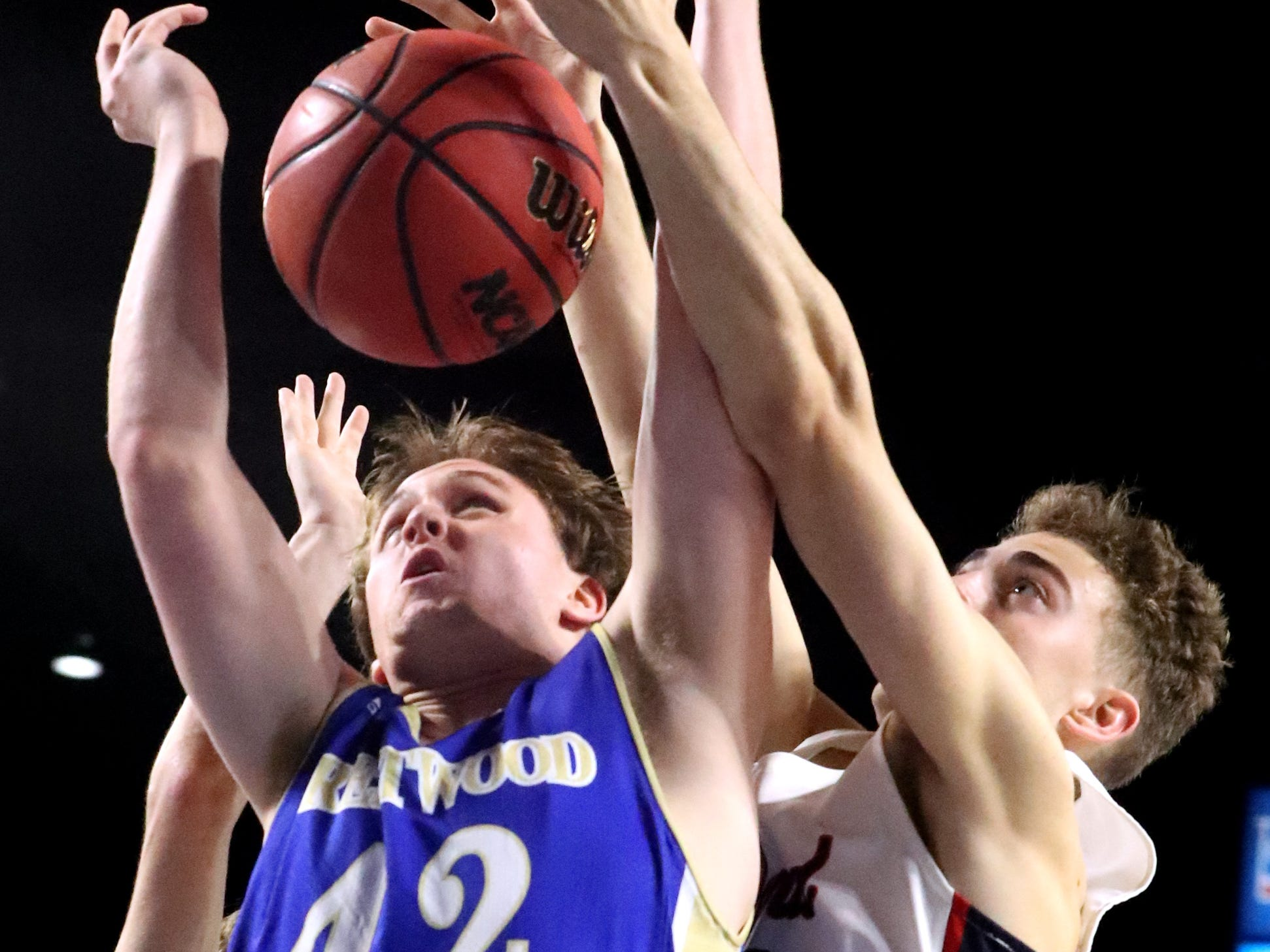 Brentwood's Evan Drennan (42) and Oakland's Carter Baughn (32) both go after a rebound during the quarterfinal round of the TSSAA Class AAA Boys State Tournament, on Thursday, March 14, 2019, at Murphy Center in Murfreesboro, Tenn.