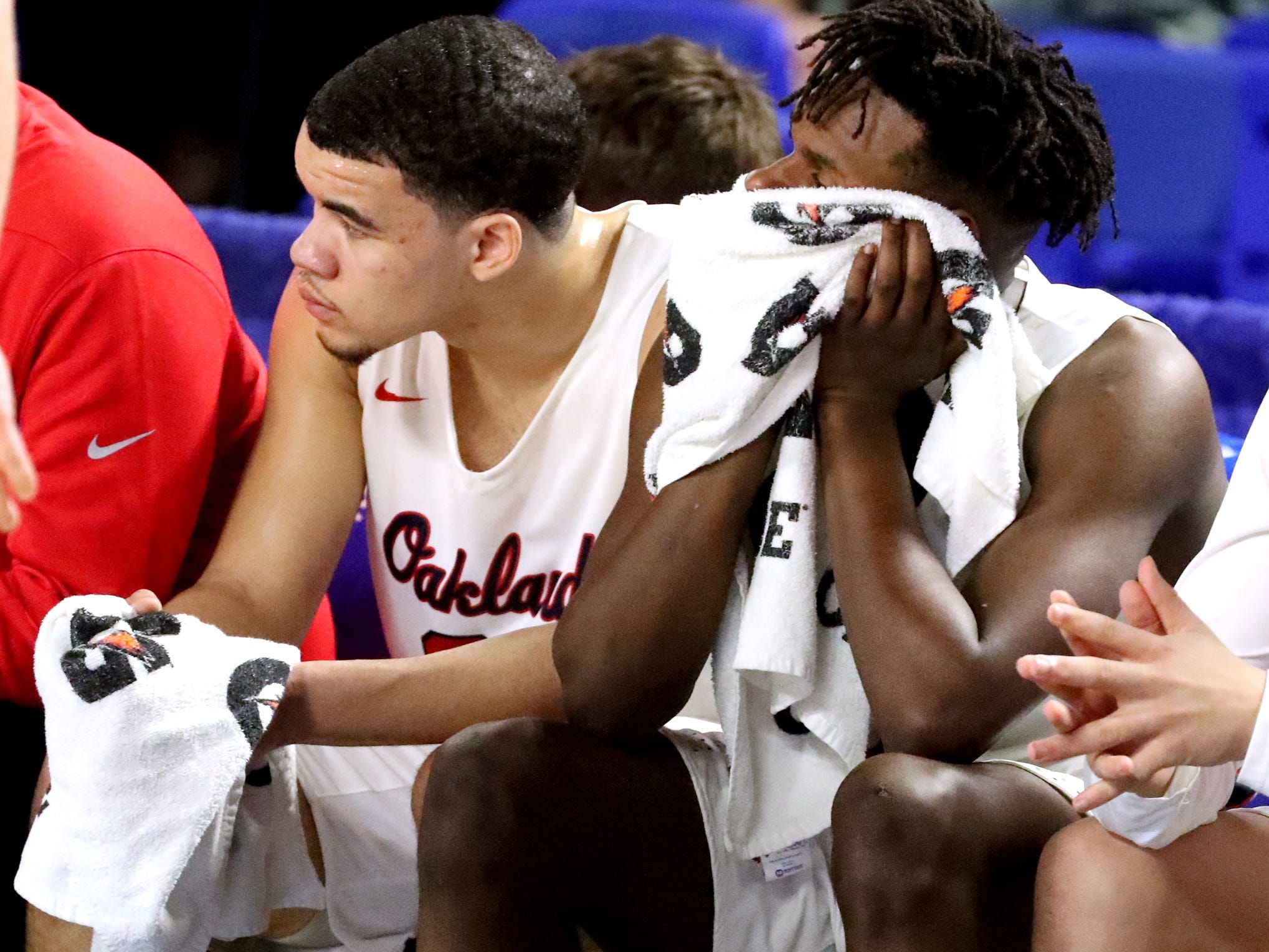Oakland senior Lamarius Jackson (25), left, and Oakland junior Mandrell Grant (4), right watch the final seconds of the overtime game from the bench as they lose to Brentwood 50-47 in overtime in the quarterfinal round of the TSSAA Class AAA Boys State Tournament, on Thursday, March 14, 2019, at Murphy Center in Murfreesboro, Tenn.