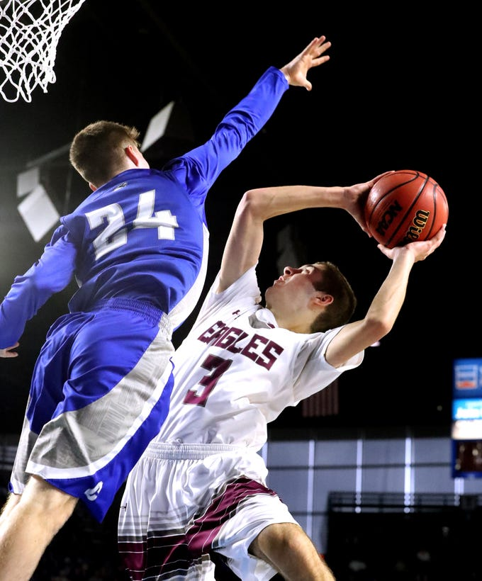 Eagleville's Ryley McClaran (3) shoots the ball as Cosby's Jeremy Wise (24) guards him during the quarterfinal round of the TSSAA Class A Boys State Tournament, on Thursday, March 14, 2019, at Murphy Center in Murfreesboro, Tenn.