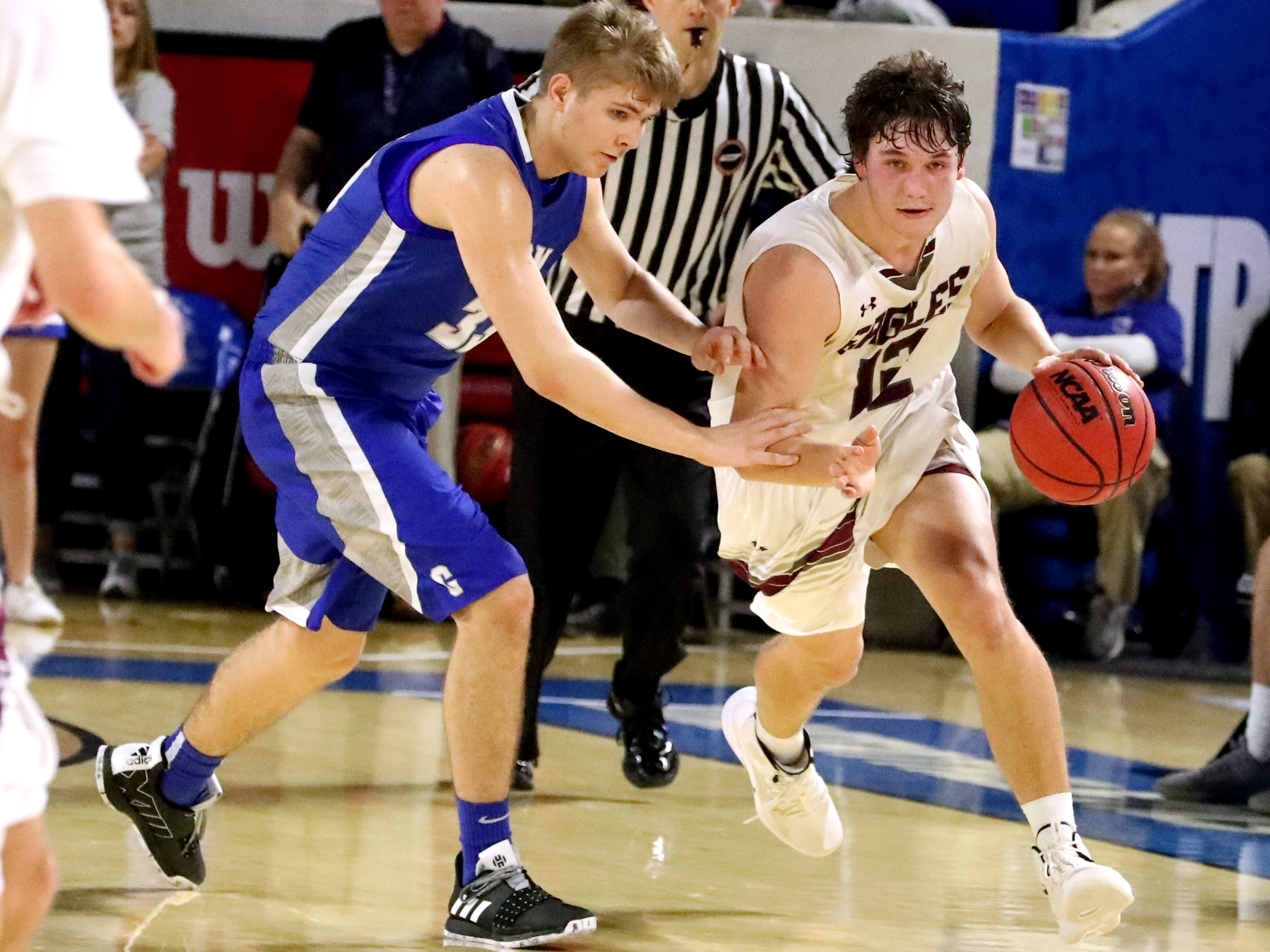 Eagleville's Ethan Cobb (12) brings the ball up the court as Cosby's Riley Galler (33) tries to steal the ball away during the quarterfinal round of the TSSAA Class A Boys State Tournament, on Thursday, March 14, 2019, at Murphy Center in Murfreesboro, Tenn.