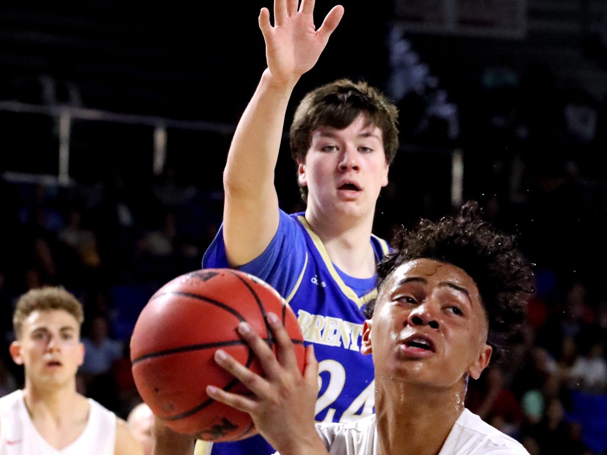 Oakland's Jaden Jamison (24) goes up for a shot as Brentwood's Cole Massey (24) guards him during the quarterfinal round of the TSSAA Class AAA Boys State Tournament, on Thursday, March 14, 2019, at Murphy Center in Murfreesboro, Tenn.
