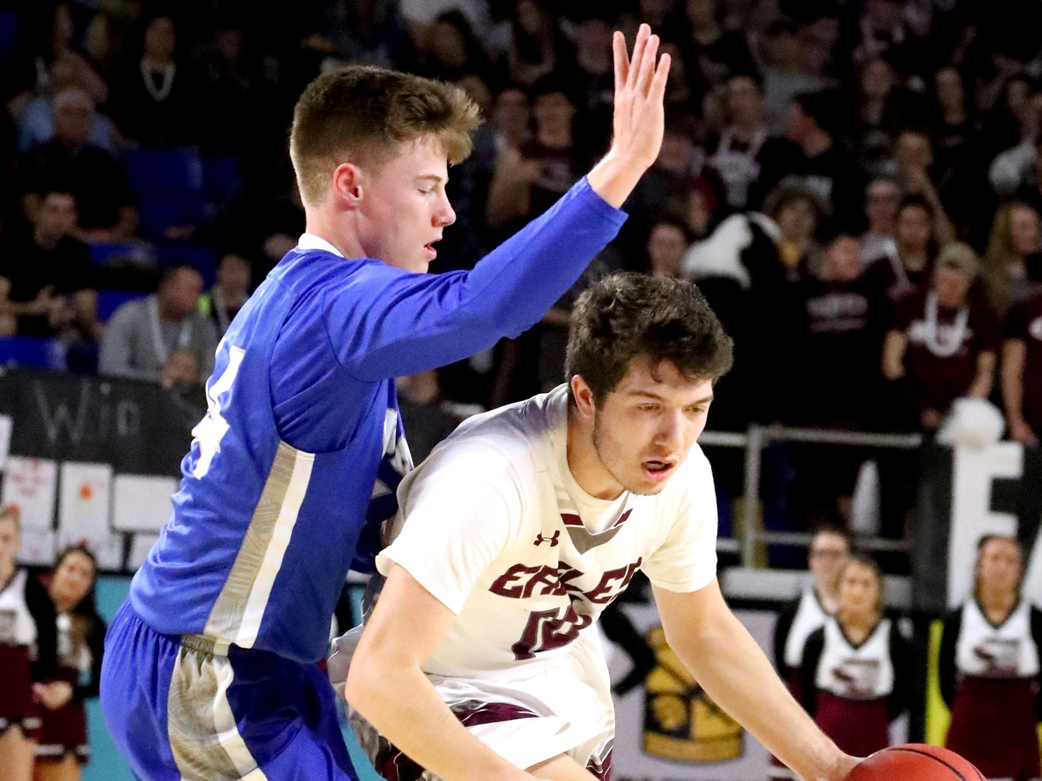 Eagleville's Bryson Kelley (10) moves around Cosby's Jeremy Wise (24) during the quarterfinal round of the TSSAA Class A Boys State Tournament, on Thursday, March 14, 2019, at Murphy Center in Murfreesboro, Tenn.