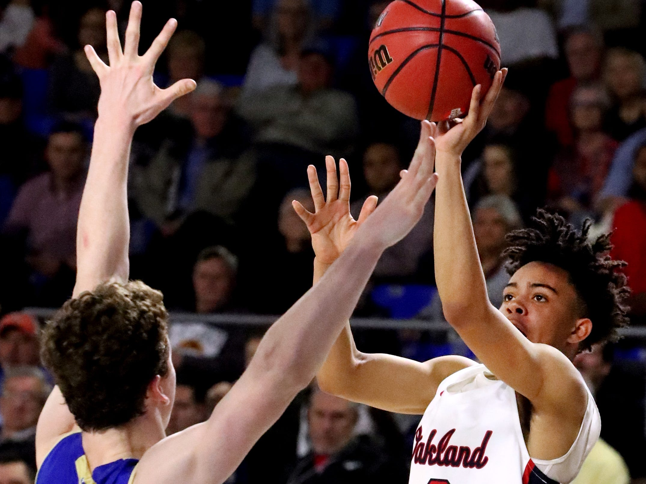 Oakland's Lonnie Tyler (2) shoots the ball as Brentwood's Ben Mills (34) guards him during the quarterfinal round of the TSSAA Class AAA Boys State Tournament, on Thursday, March 14, 2019, at Murphy Center in Murfreesboro, Tenn.