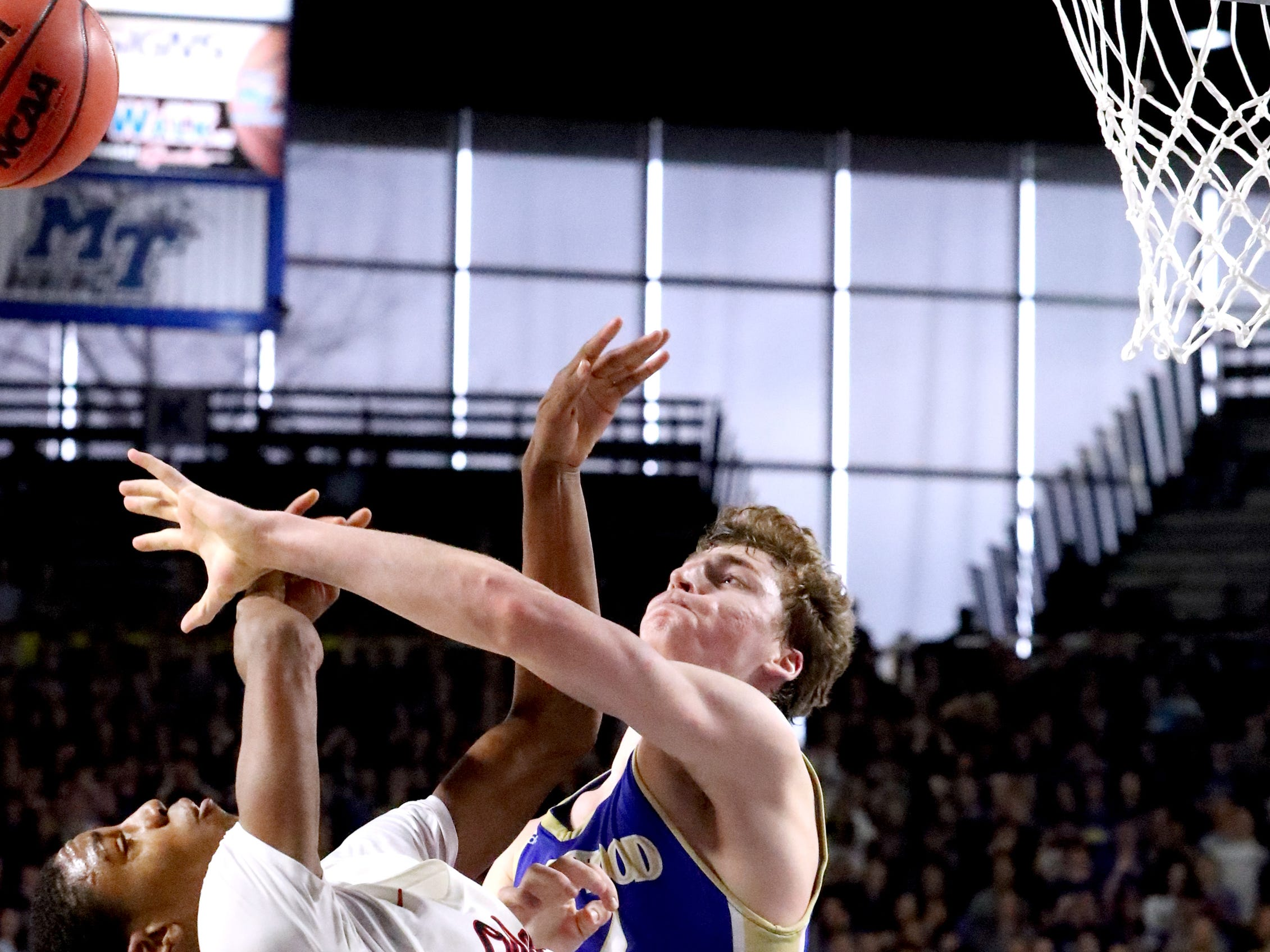 Brentwood's Ben Mills (34) fouls Oakland's Dorian Anderson (23) as he goes up for a shot during the quarterfinal round of the TSSAA Class AAA Boys State Tournament, on Thursday, March 14, 2019, at Murphy Center in Murfreesboro, Tenn.