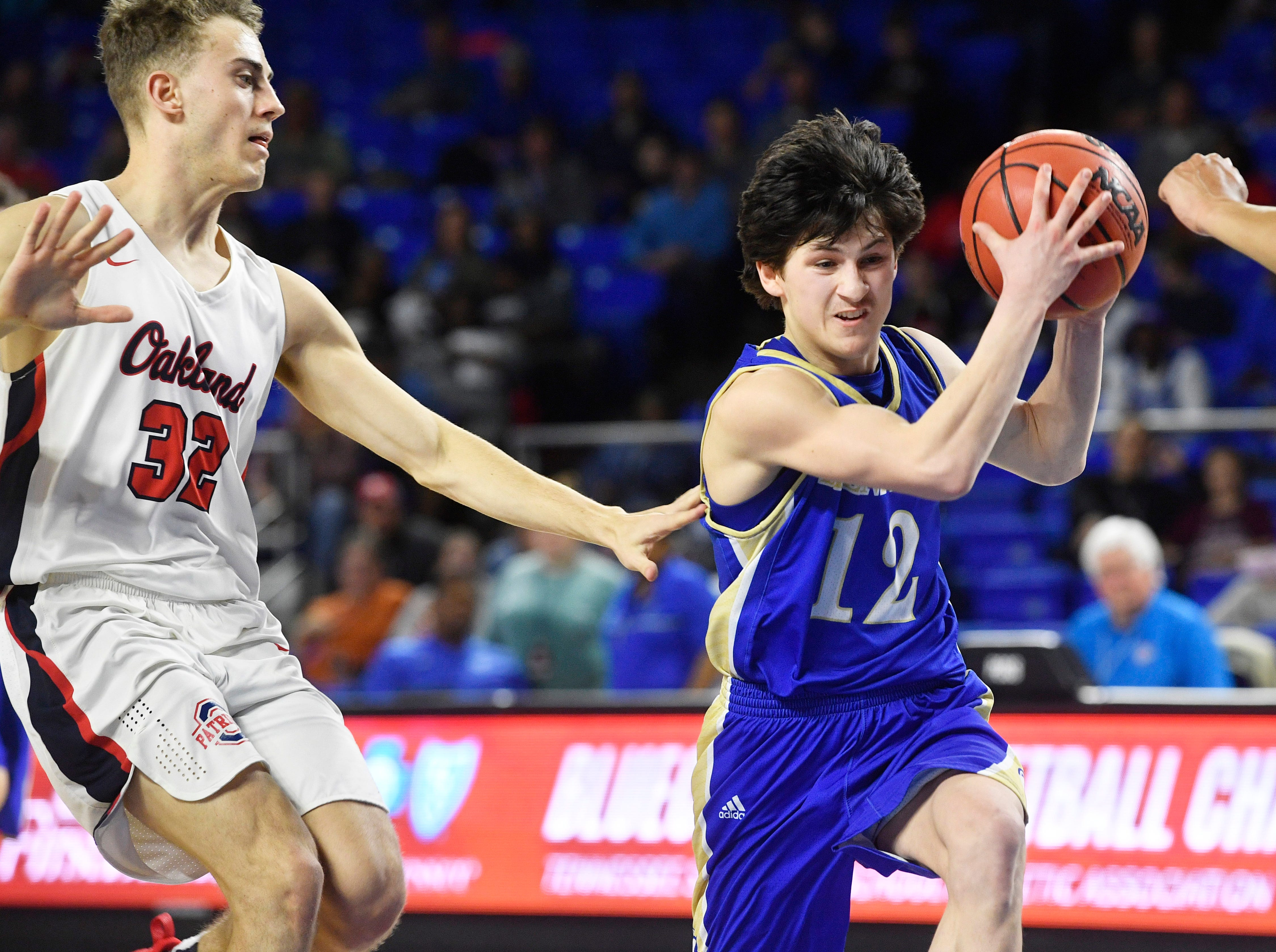 Brentwood's Preston Moore (12) goes for the score as Brentwood plays Oakland in the TSSAA Class AAA quarterfinals Thursday, March 14, 2019, in Murfreesboro, Tenn.