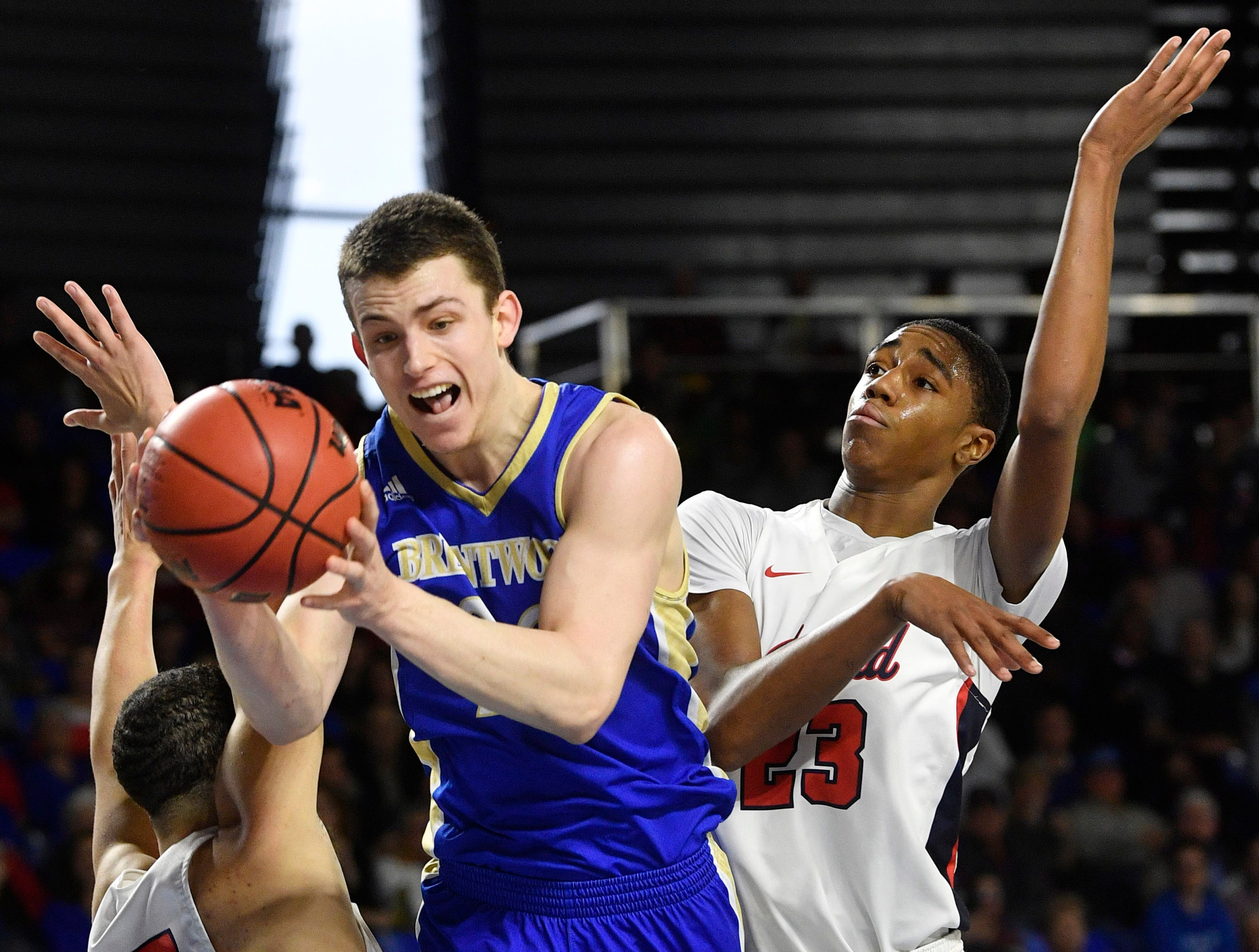 Brentwood's Harry Lackey (22) fights through defenders as Brentwood plays Oakland in the TSSAA Class AAA quarterfinals  Thursday, March 14, 2019, in Murfreesboro, Tenn.