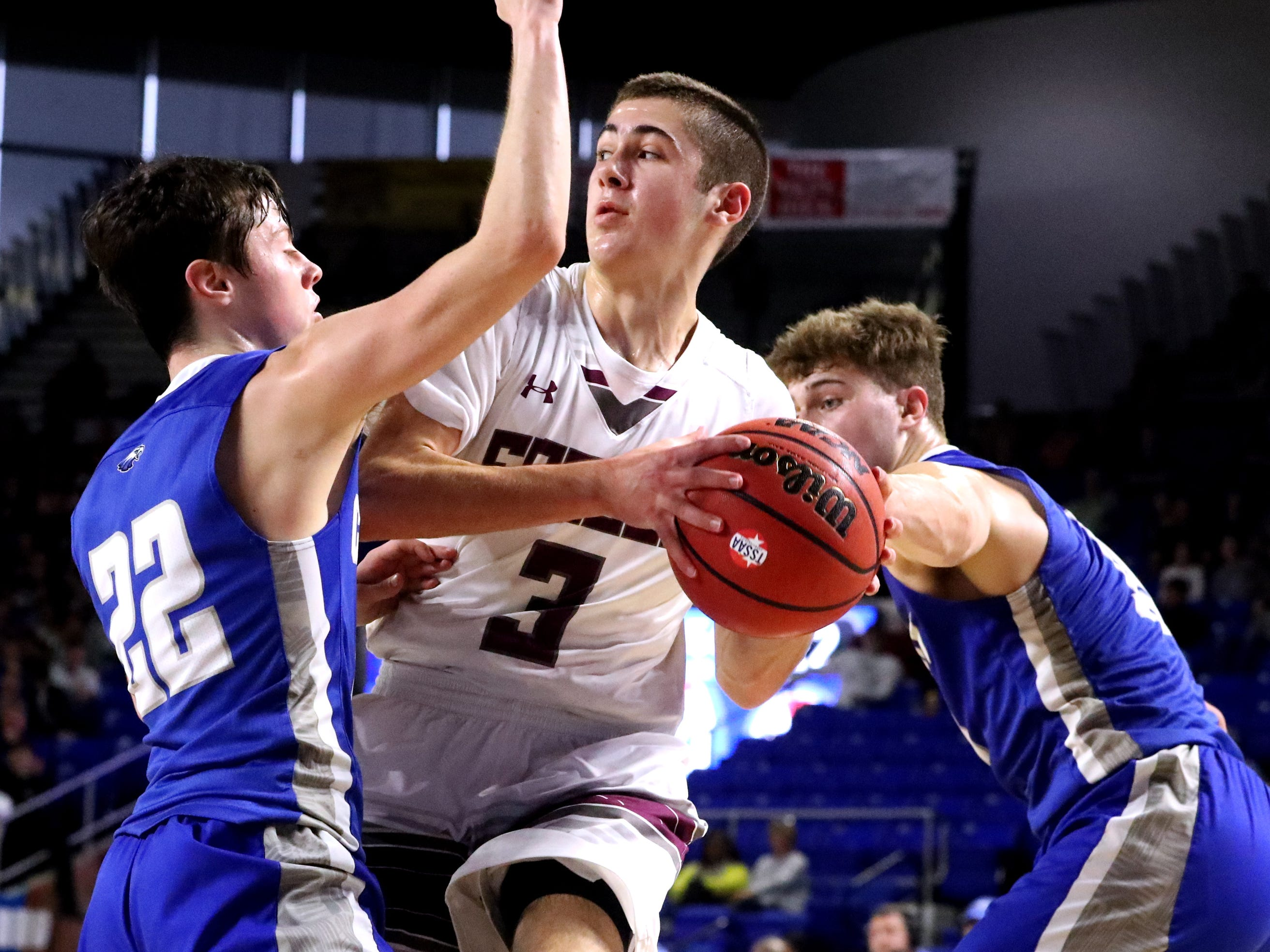Eagleville's Ryley McClaran (3) looks to pass the ball between Cosby's Braden Shaffer (22) and Austin McKeehan (13) during the quarterfinal round of the TSSAA Class A Boys State Tournament, on Thursday, March 14, 2019, at Murphy Center in Murfreesboro, Tenn.