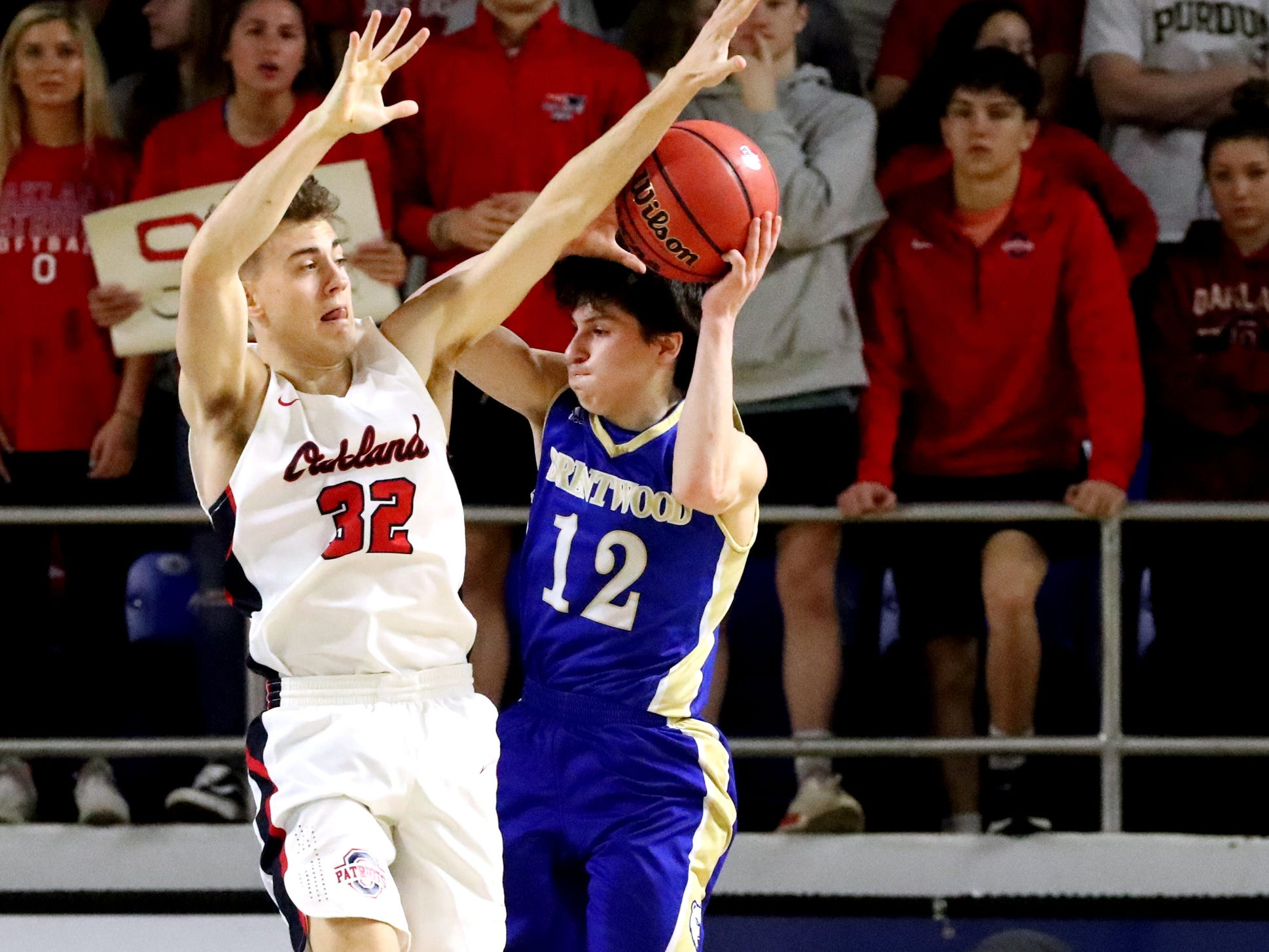 Brentwood's Preston Moore (12) shoots the ball as Oakland's Carter Baughn (32) guards him during the quarterfinal round of the TSSAA Class AAA Boys State Tournament, on Thursday, March 14, 2019, at Murphy Center in Murfreesboro, Tenn.