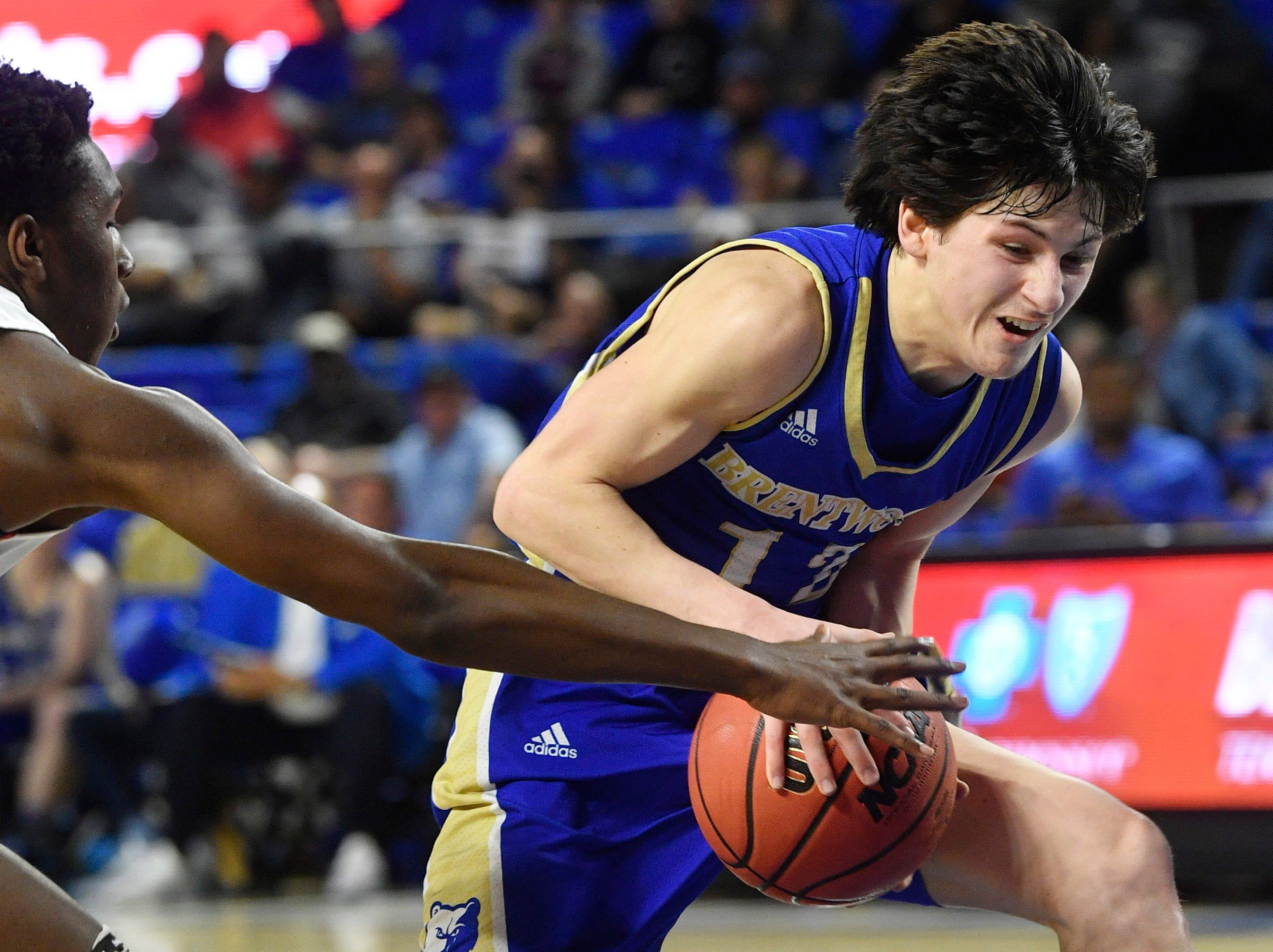 Brentwood's Preston Moore (12) drives for the basket as Brentwood plays Oakland in the TSSAA Class AAA quarterfinals Thursday, March 14, 2019, in Murfreesboro, Tenn.